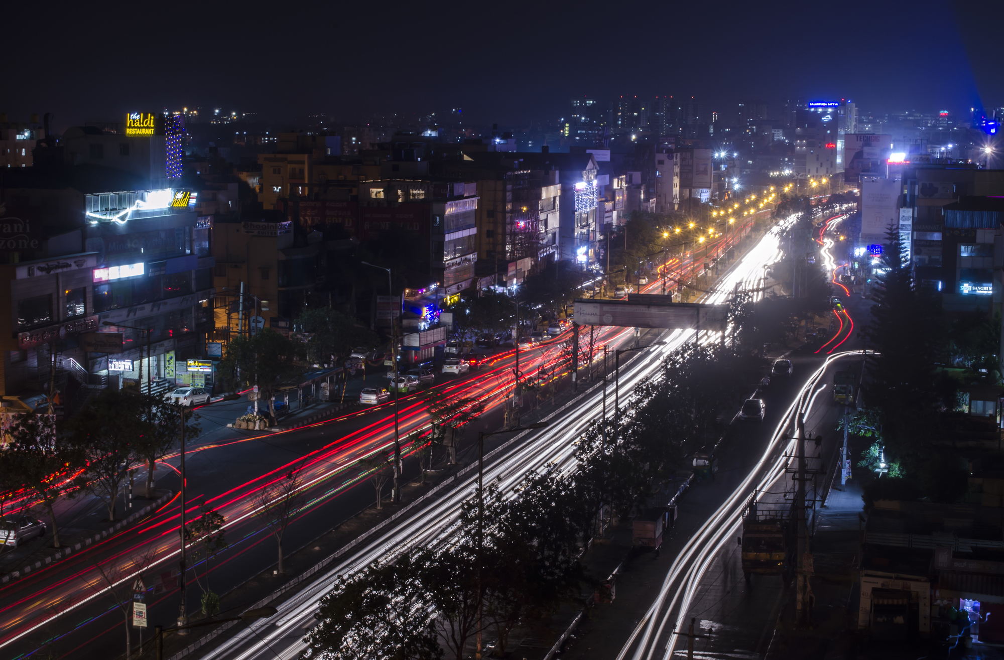 A birds eye view of the four lane outer ring road, this has the oncoming yellow light trail, as well as the red light trails from away traffic.