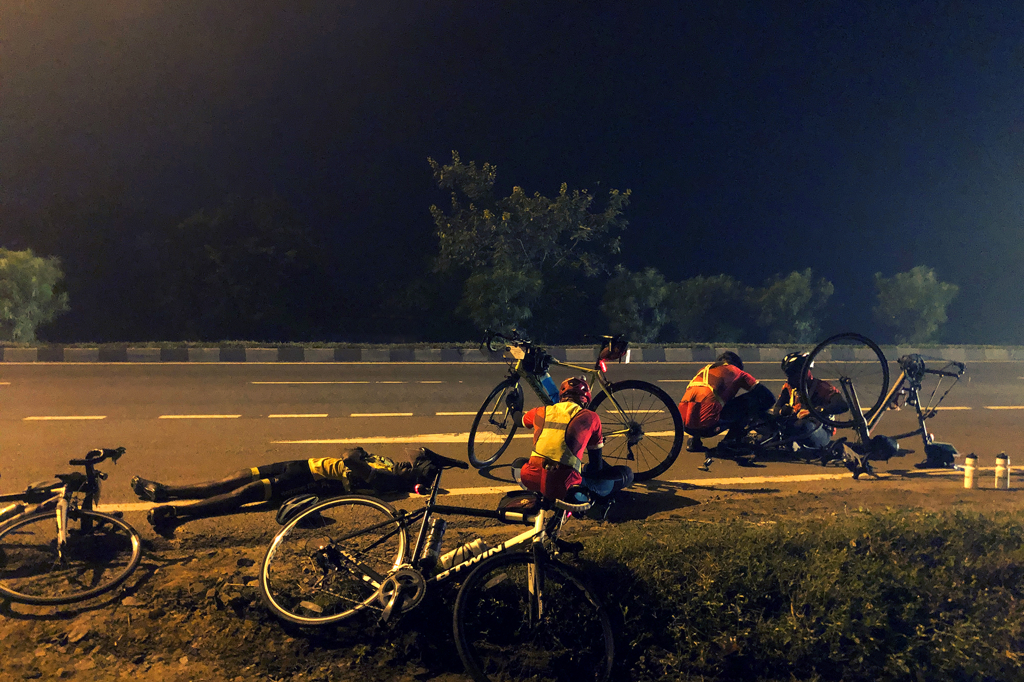 The image looks like its straight out of a gory accident scene. This is the world of an endurance ride where cyclists are on the pedal for two consecutive days to cover 600KMs or more. A 10 minute recharge break every few hours is all the time they get to catch a wink and service their cycles. Who bothers about etiquette or niceties then?