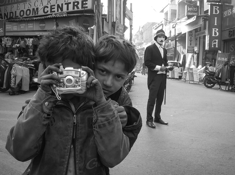 While roaming the streets of Rajouri Garden, I spotted these kids. When they saw my camera, they took theirs out and proudly showed it to me.