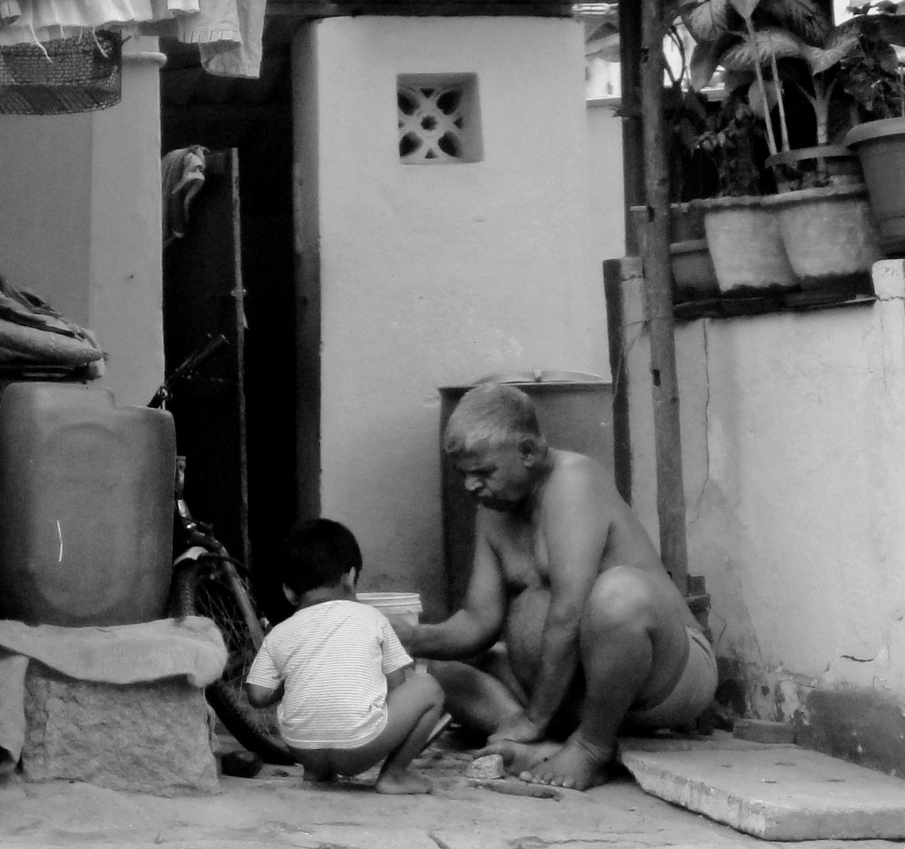I was on My way home and I looked at this old man with his grandson, it was a priceless moment NOT to be missed at any cost, in this digital age almost everyone is becoming a slave of DIGI products in such a time ,this was truly a welcome site.