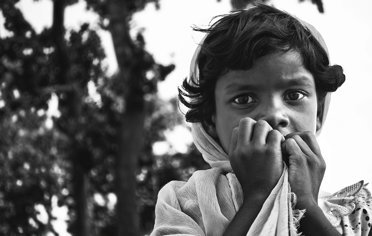 i choose contrasting lights that helps black and white portraits look better. a direct eye contact with Salma when she was collecting dried leaves.