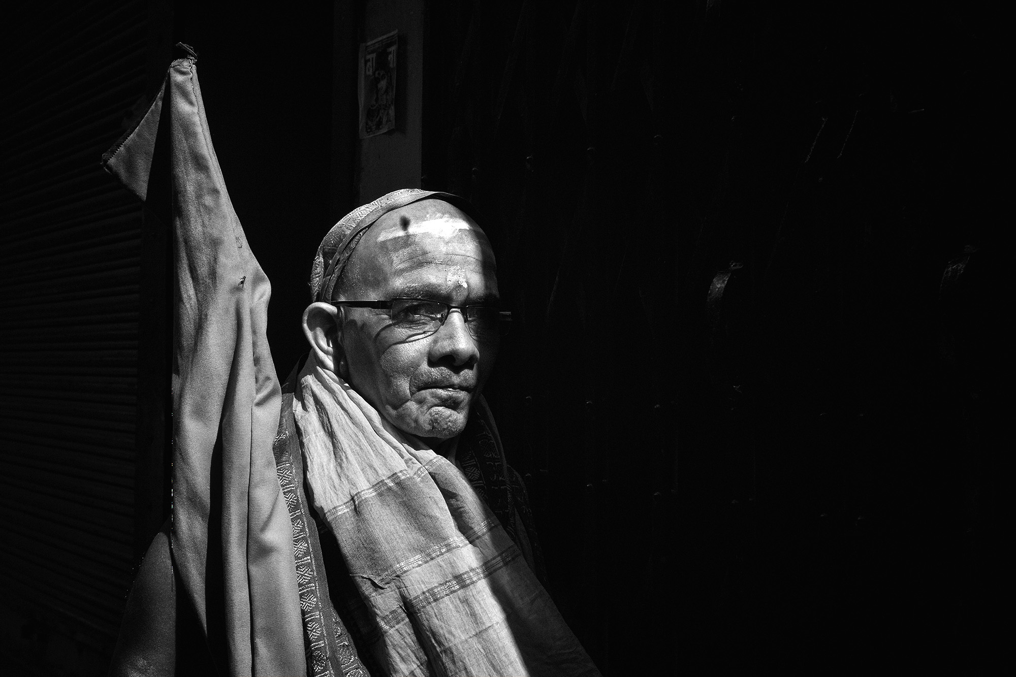 This snap was taken in the by-lanes of Varanasi. The split light & the ambiance was the inspiration behind this click.