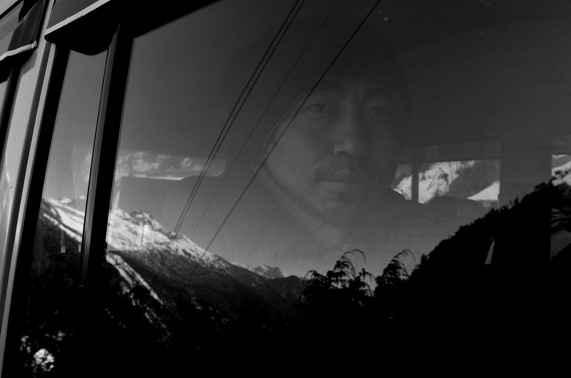 Got this man at a car near Guridongmar lake... He is a Sikkimist driver, who is observing outside through the glass of car window. . Attracted by the blending of nature and human presence... . Enjoy it.