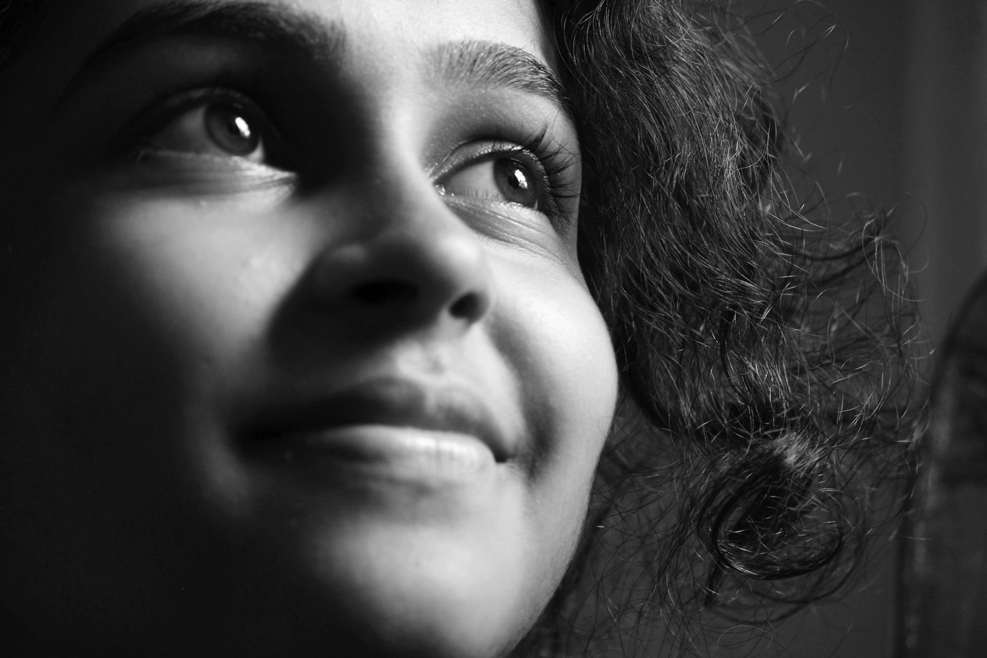 This simple photo in Black & White strongly delivers the intensity of sparkle in the eyes, which represents a ray of positive hope & the confidence. The depth of the expressions & feelings can be delivered more precisely in B&W rather than with colours.