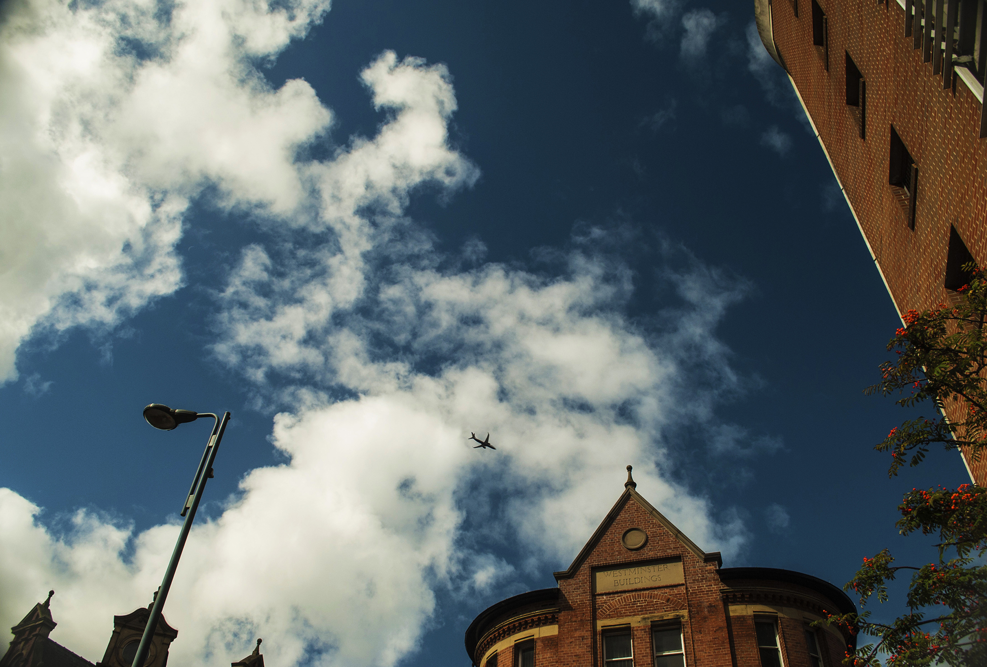 Captured this shot while walking down the streets of Leeds as a plane flies over