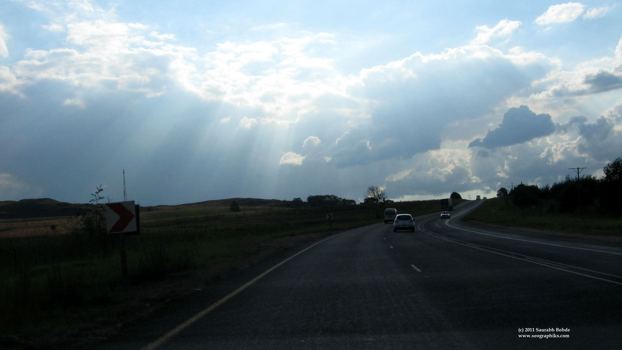 Sunrays shine through a cloudy sky, putting things in the spotlight. (Taken at 100kmph+!)