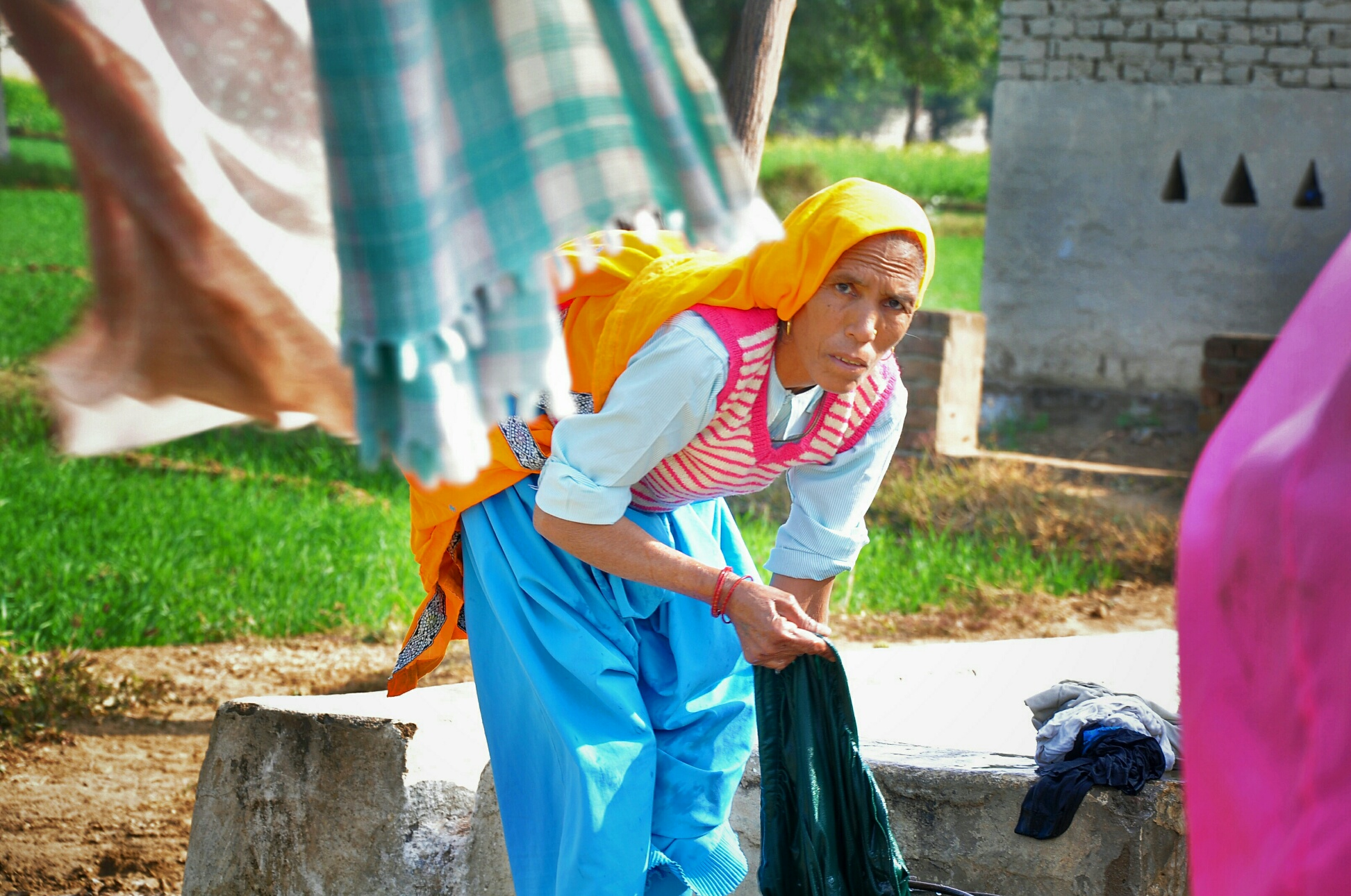 A village housewife with tagline that she don't do 'anything' but work whole day...
