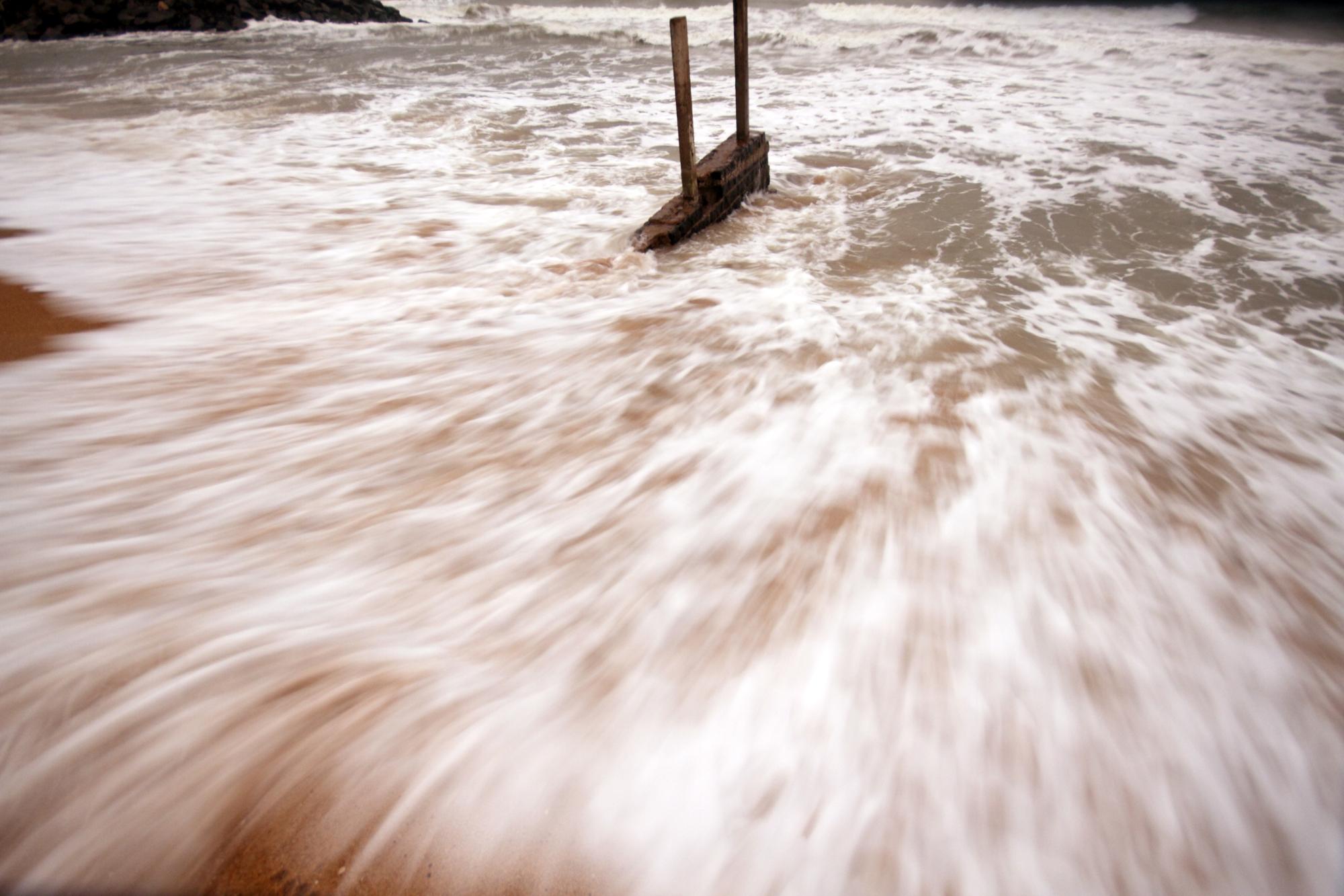 Waves going back on Mahabalipuram beach.