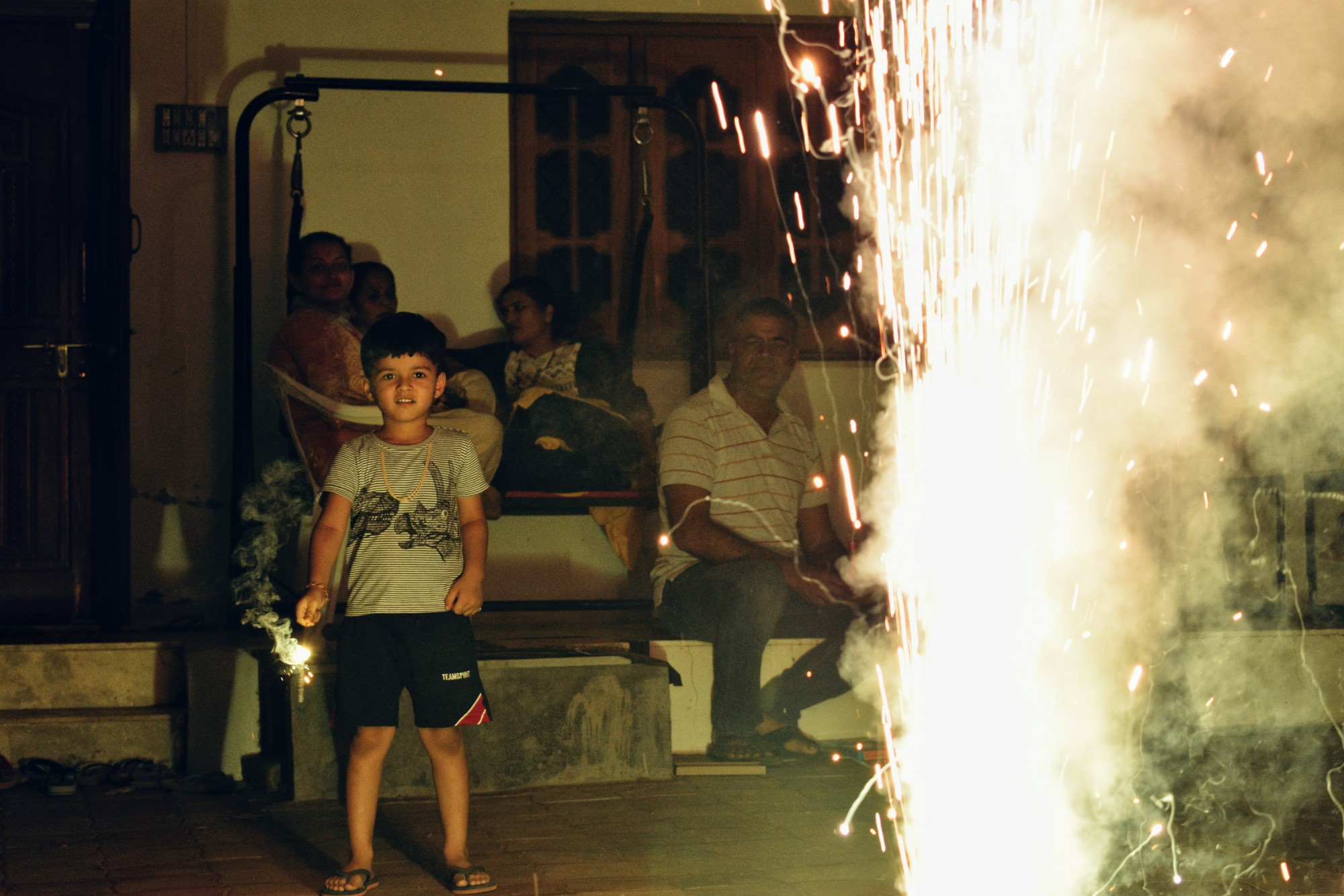 My cousin brother is enjoying diwali.