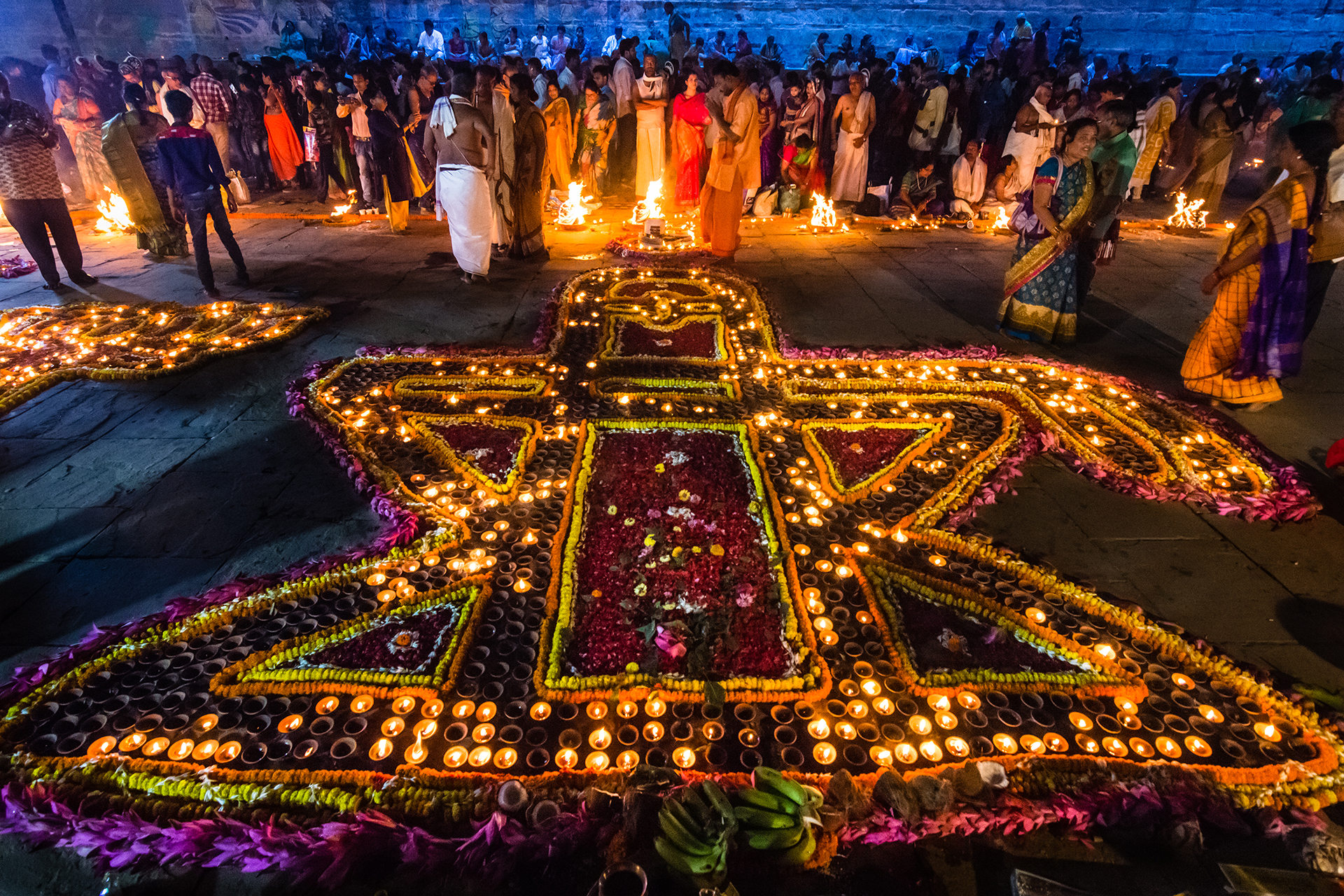 Devotees lighting Dia's on the occasion of a Dev Deepawali in Varanasi.