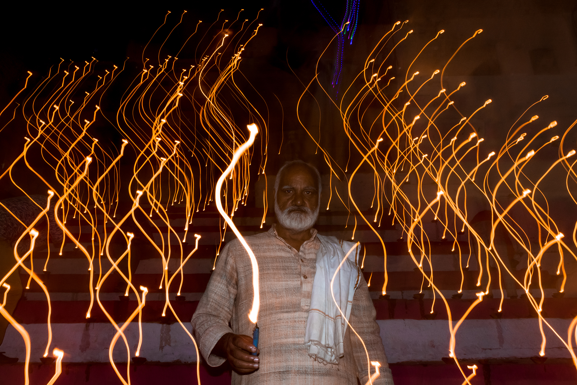 Man lights diyas on the occasion of Dev Deepawali, a festival of Kartik Poornima celebrated in Varanasi, Uttar Pradesh, India. It falls on the full moon of the Hindu month of Kartika and takes place fifteen days after Diwali.