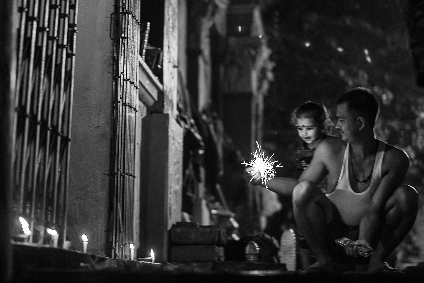 Hello, I am Swapan Dey from Kolkata. During dewali I took the picture a man enjoing his baby's expression with sparkling light.  Regards,  Swapan Dey  Email : dey072215@gmail.com Mobile no : 9830694610