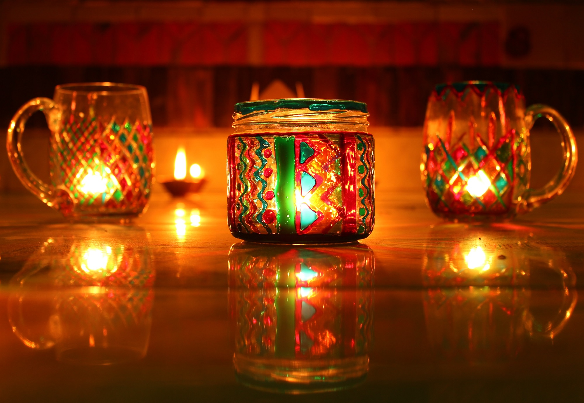 Hand painted glass jars and mugs were used as Diwali lamps, along with diyas. Together, they adorned the porch of the house this Diwali.