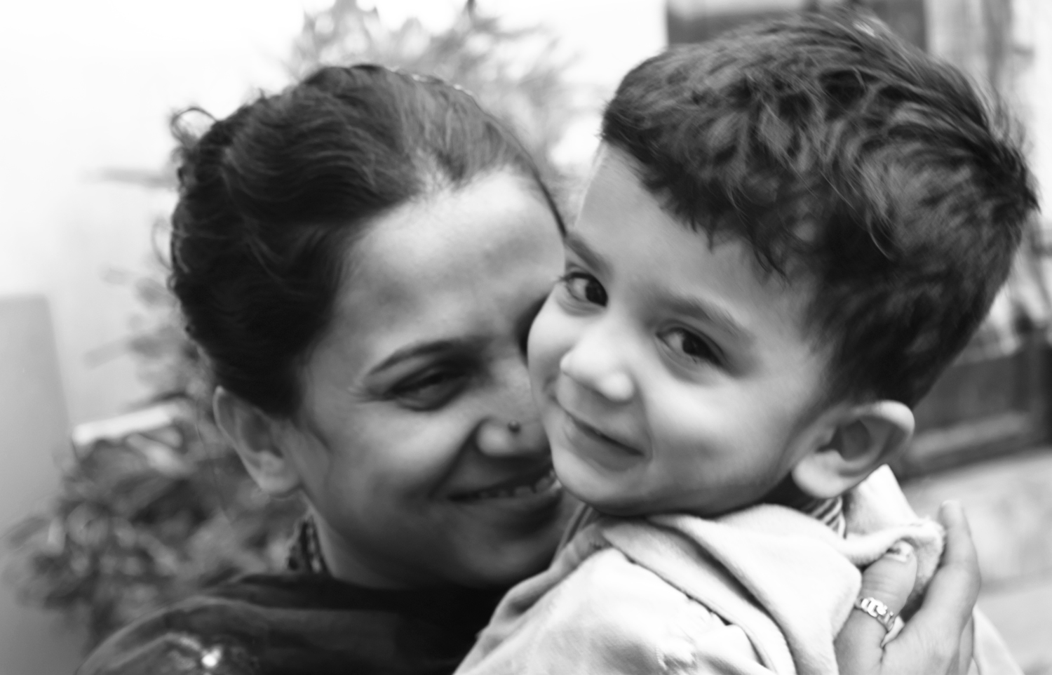 I have shot this photo when a mother cuddle her son and got their expression.