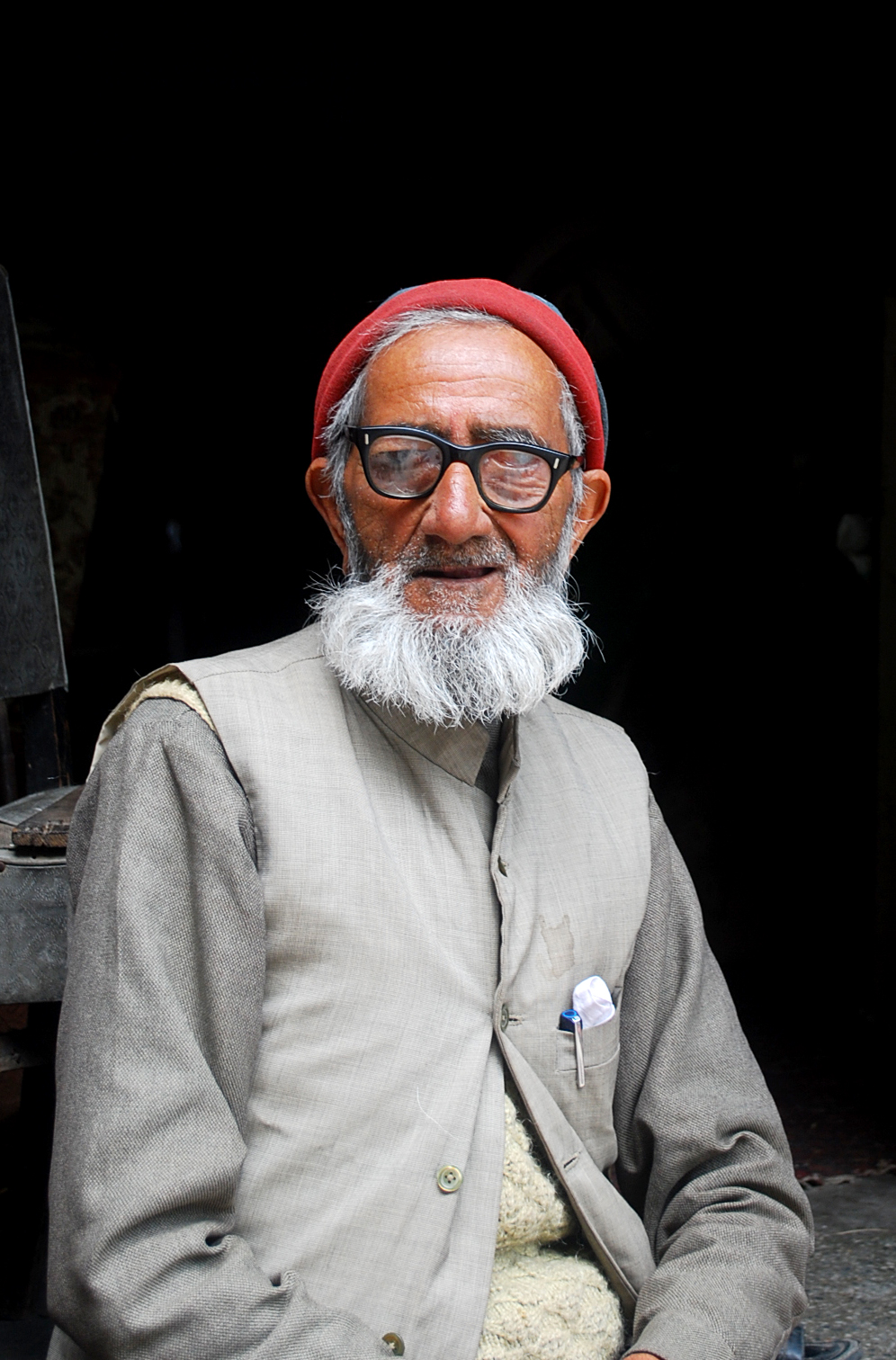 An old man sits on the threshold of his antique items' shop in the main market of Landour Cantonment in Uttarakhand.