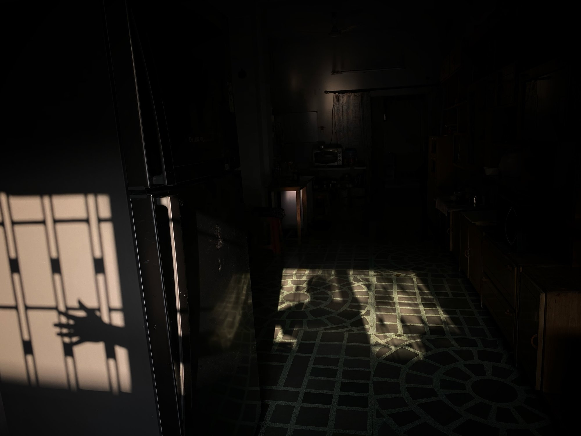 That's how light breaks through my window every morning, throwing light selectively at selective spots in my living room.