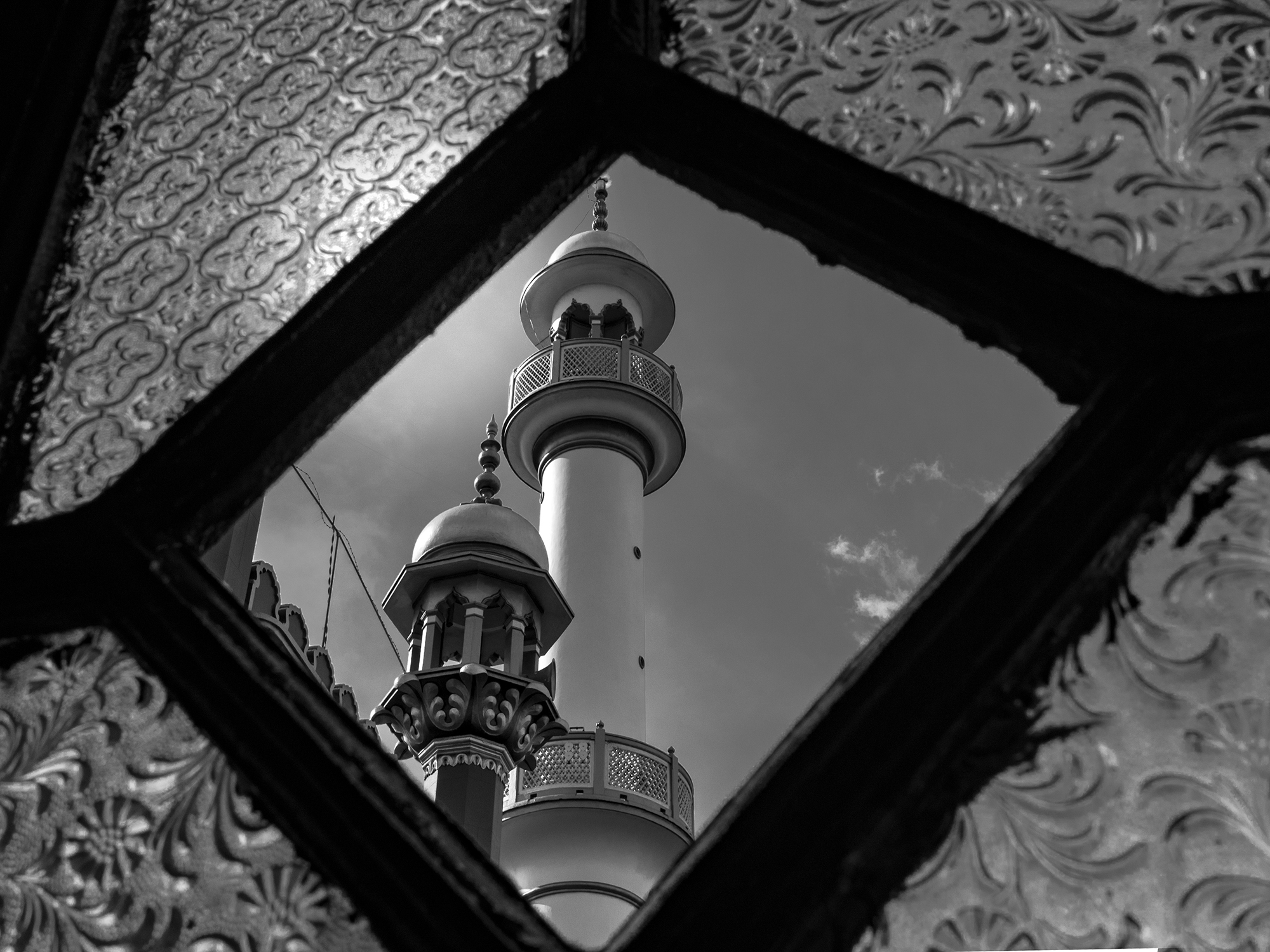 This image was taken through an old window of Nakhoda Mosque which was itself very old and considered heritage.