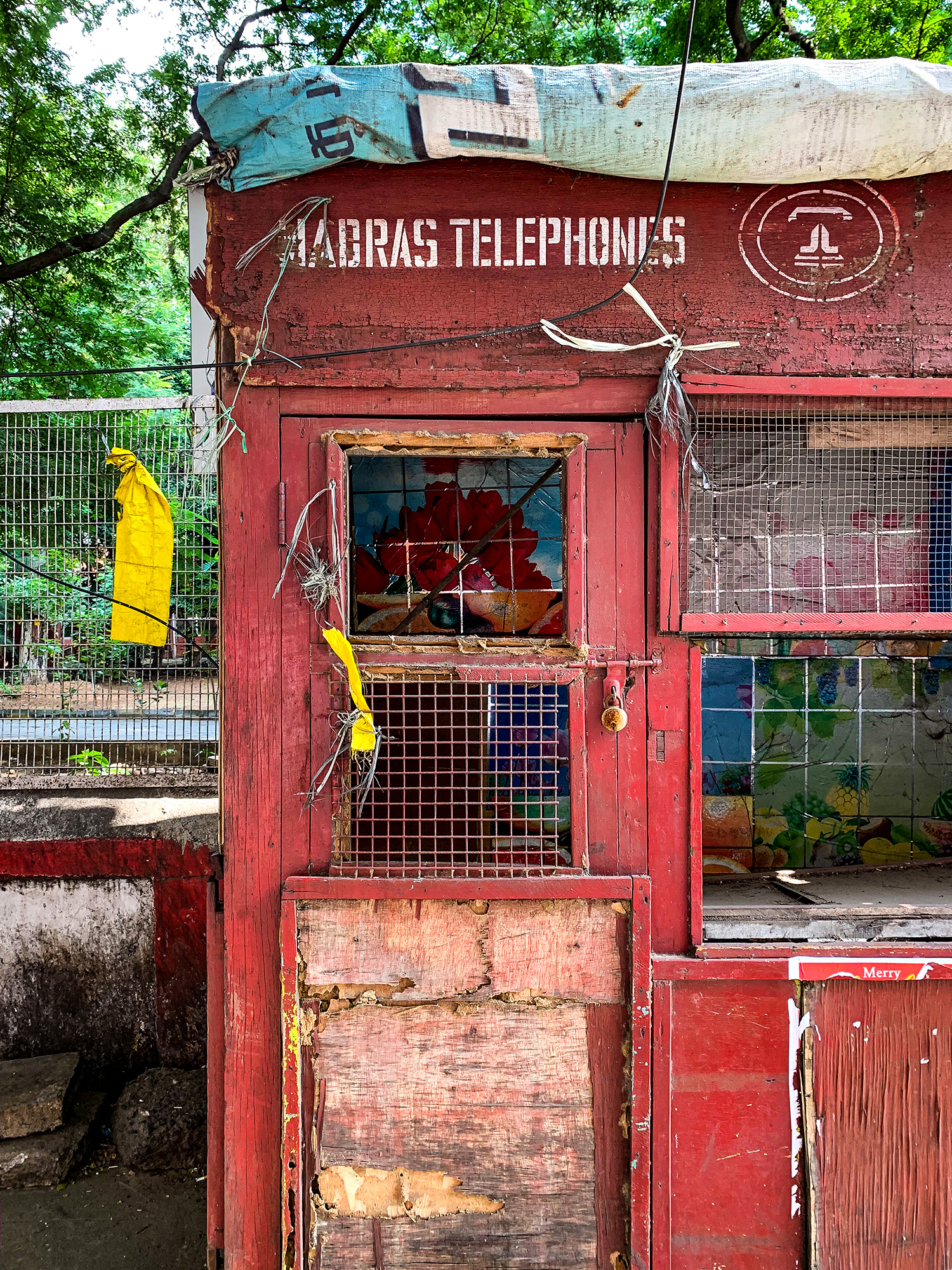 An abandoned telephone booth on the streets of Chennai.