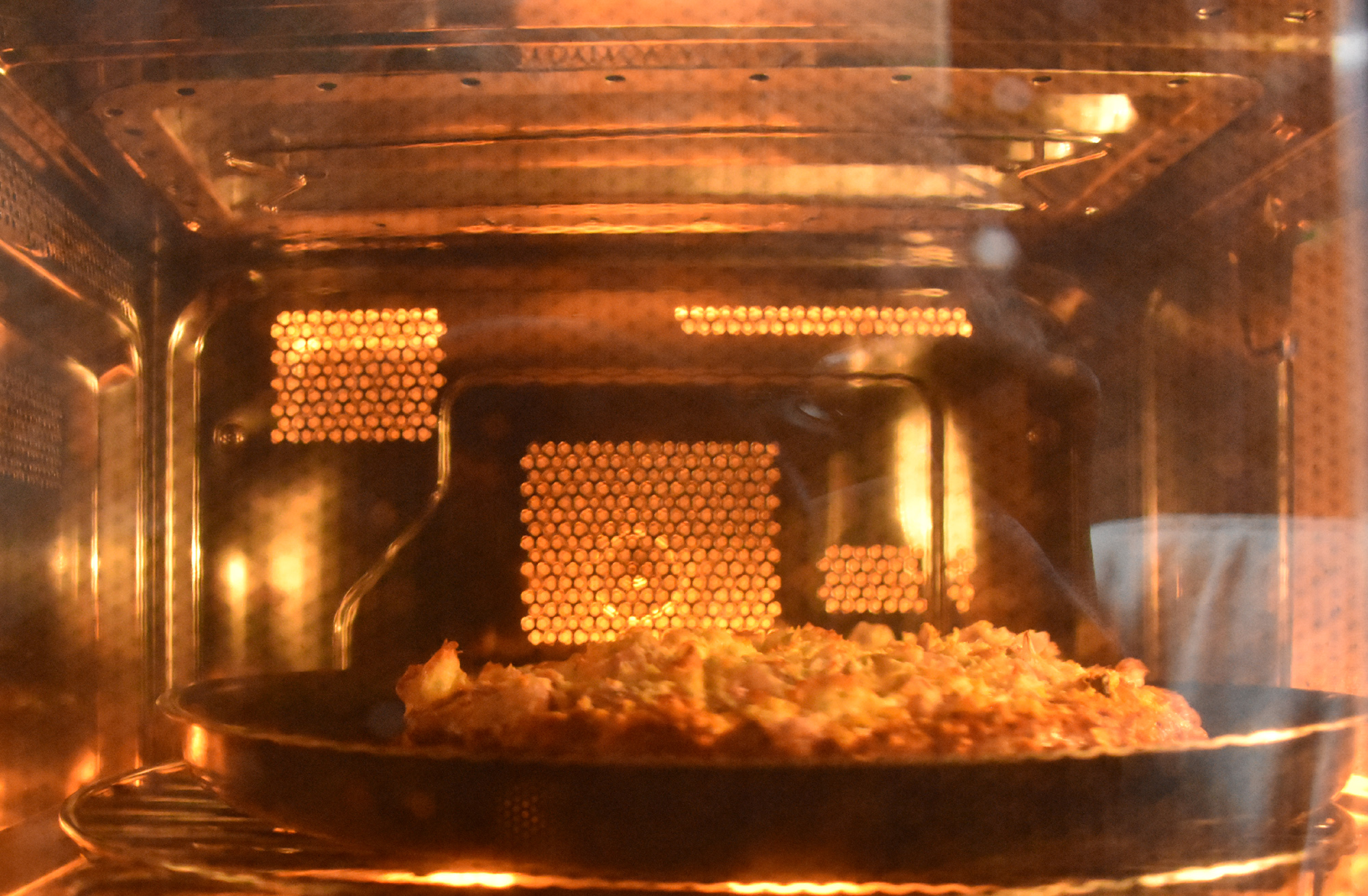 Captured a pizza being baked inside an oven