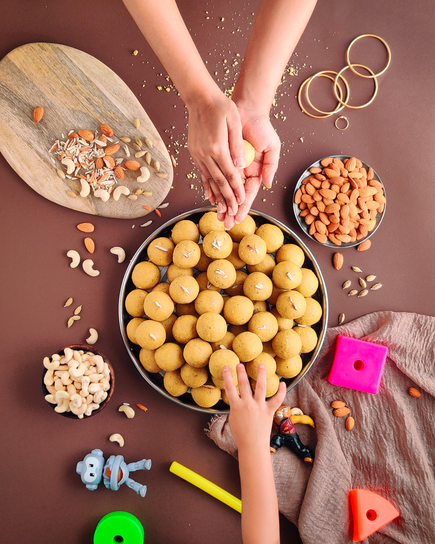 I shot this image on my cell phone, depicts the perfect situation of my childhood when I used to start eating those Besan Laddoos as soon as they were ready. Bring back all the memories!