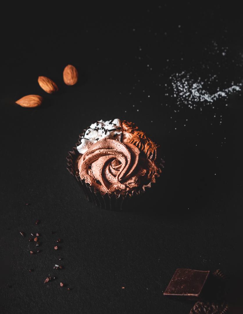 Flat lay of chocolate cupcake along with its ingredients