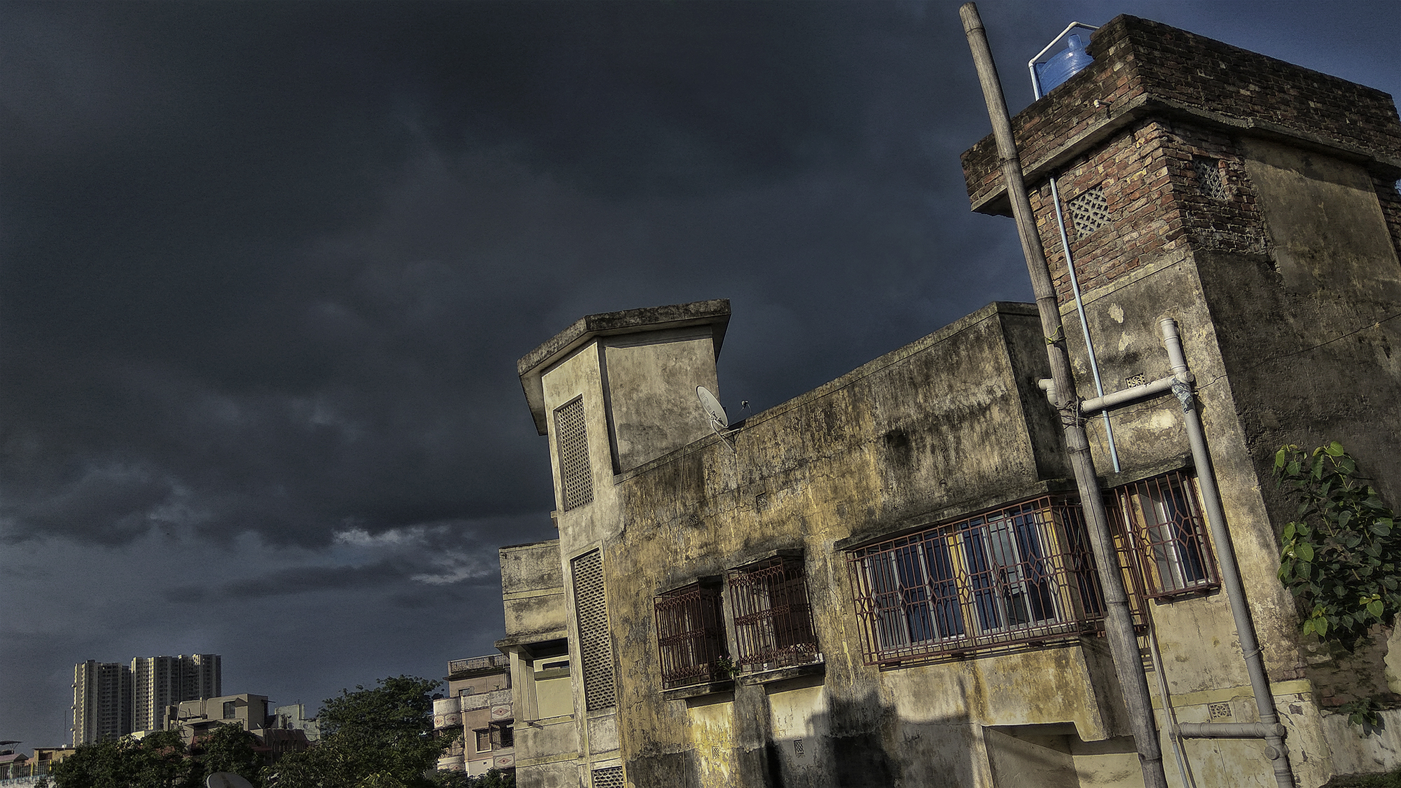 The darkest monsoon clouds float over the building, to make me happy and optimistic.
