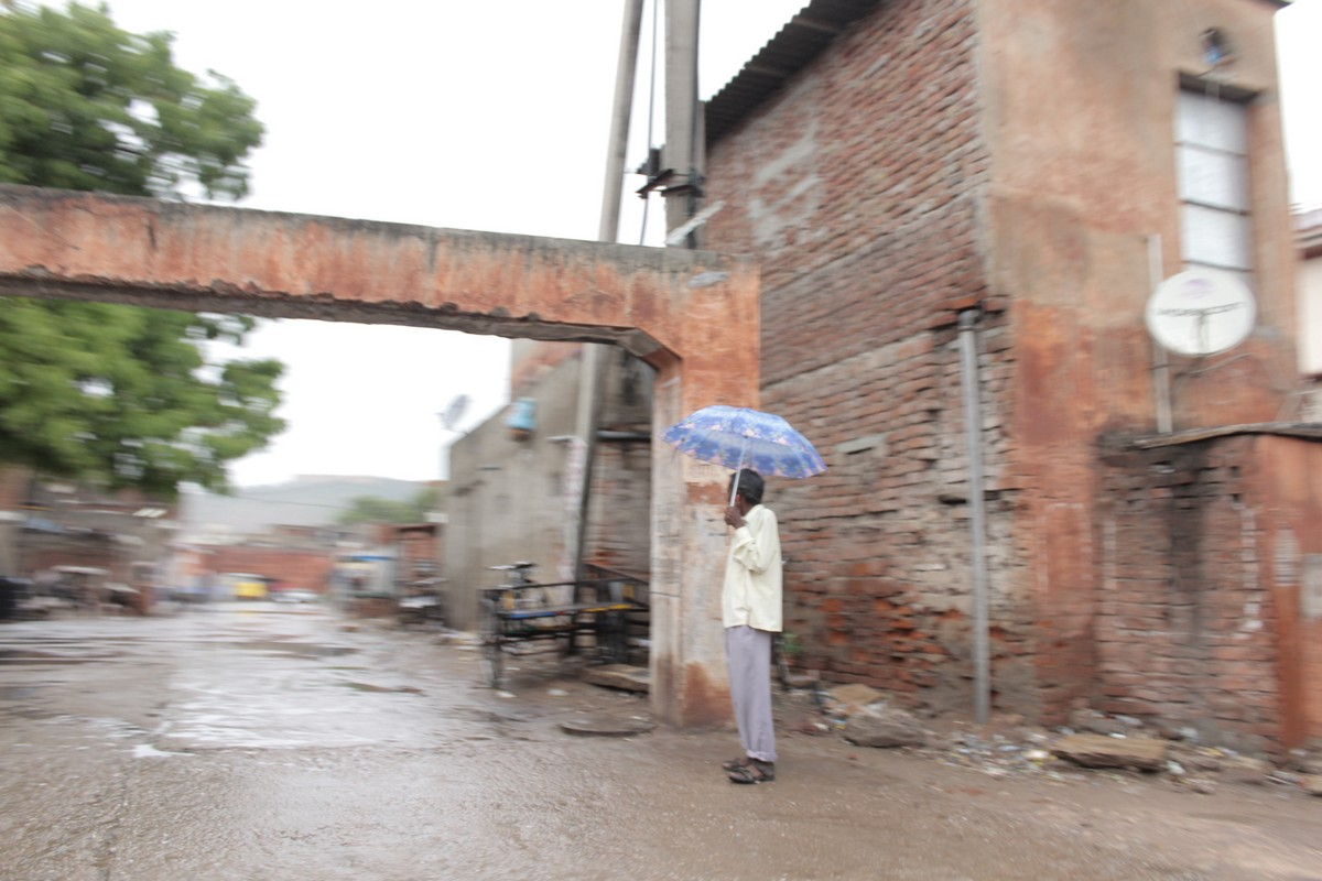 I found this alone man standing just close to a gate kind of structure in Jaipur city with a beautiful umbrella.