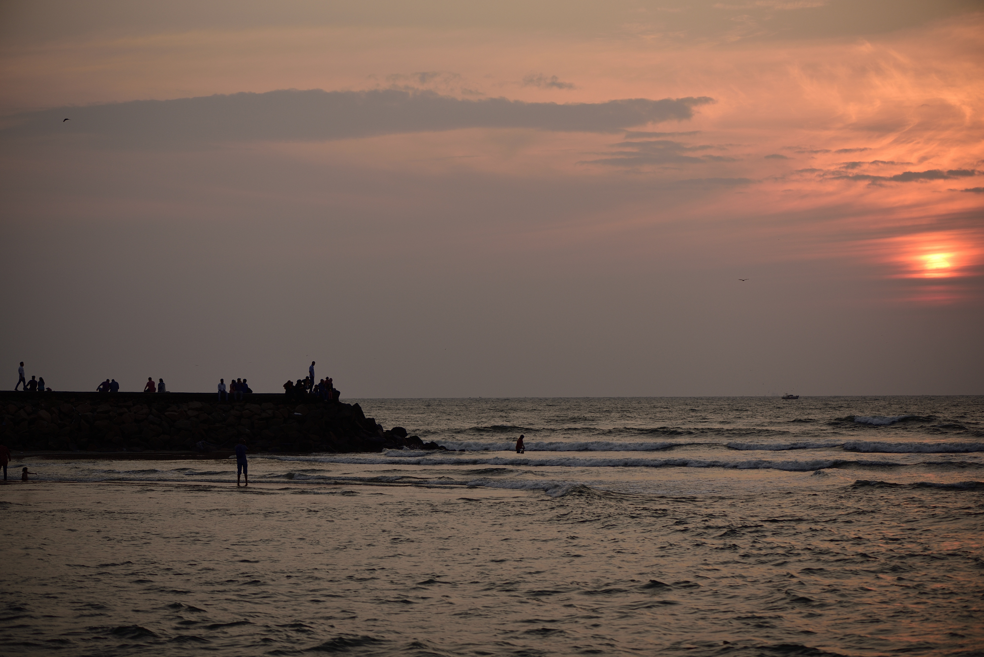 This is a beautiful setting with sun-set and silhoutte showing human life at Fort Kochi