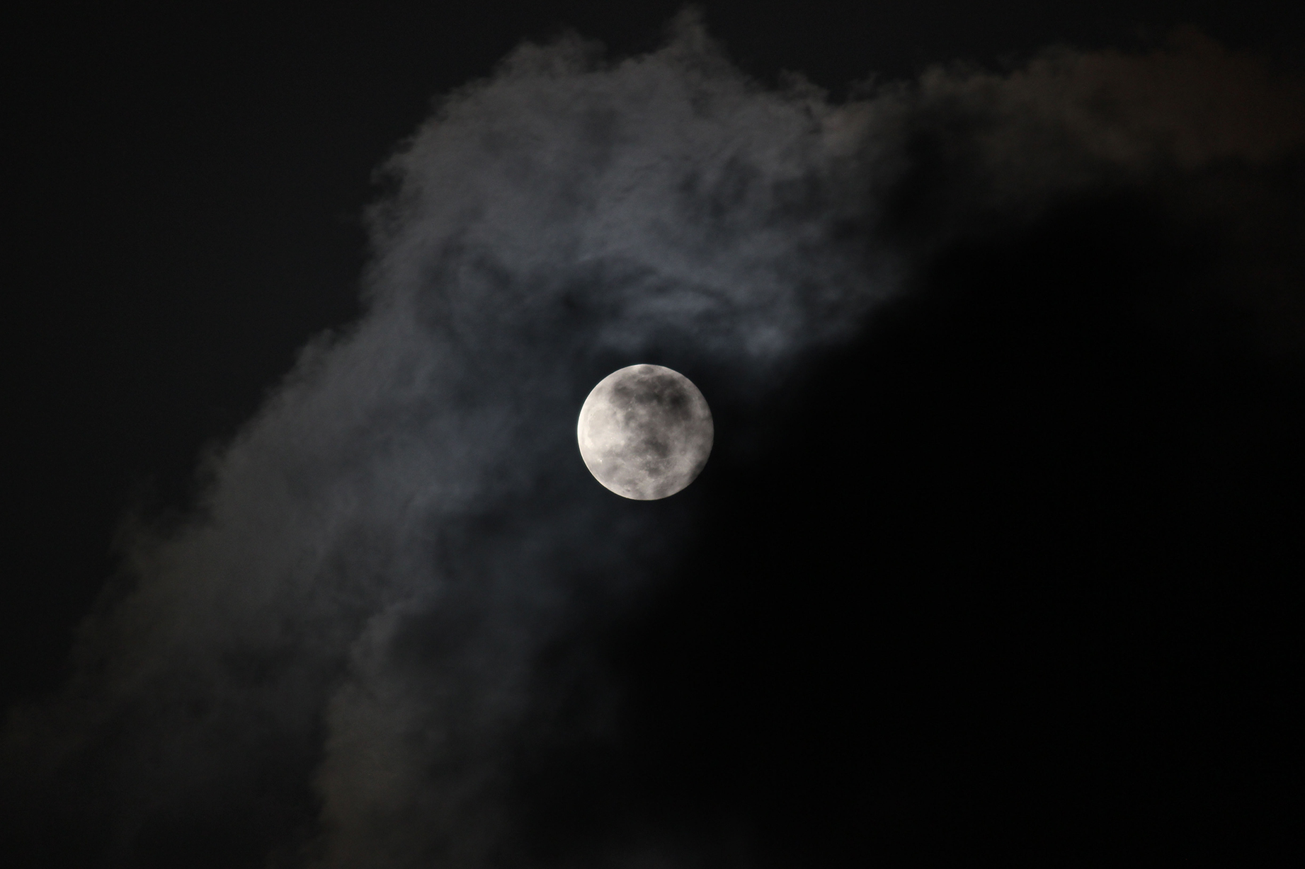 A full-moon moments before disappearing into the clouds.