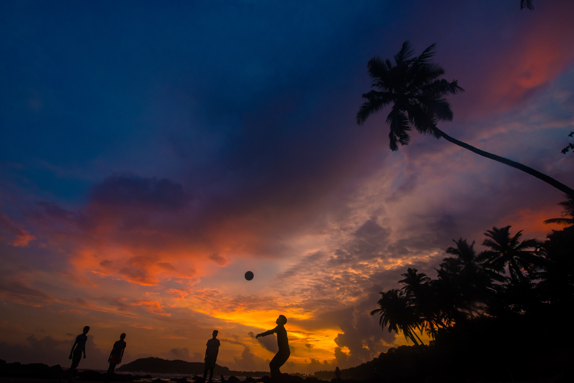 Above photo was clicked in Goa. While having walk on a beach noticed that children were playing football and there was amazing sky in the background