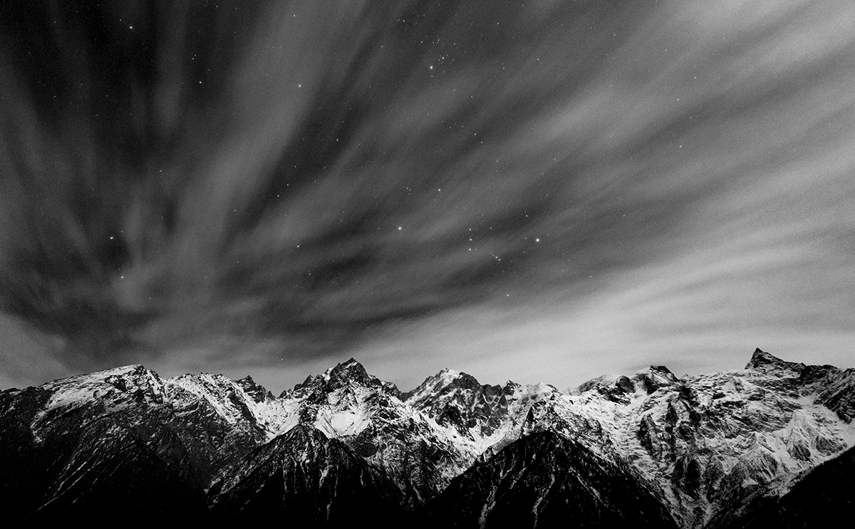 Single long exposure shot of the Kinnaur Kailash range, capturing the movement of the clouds as the stars shine through. Picture taken from Kalpa, Himachal Pradesh.