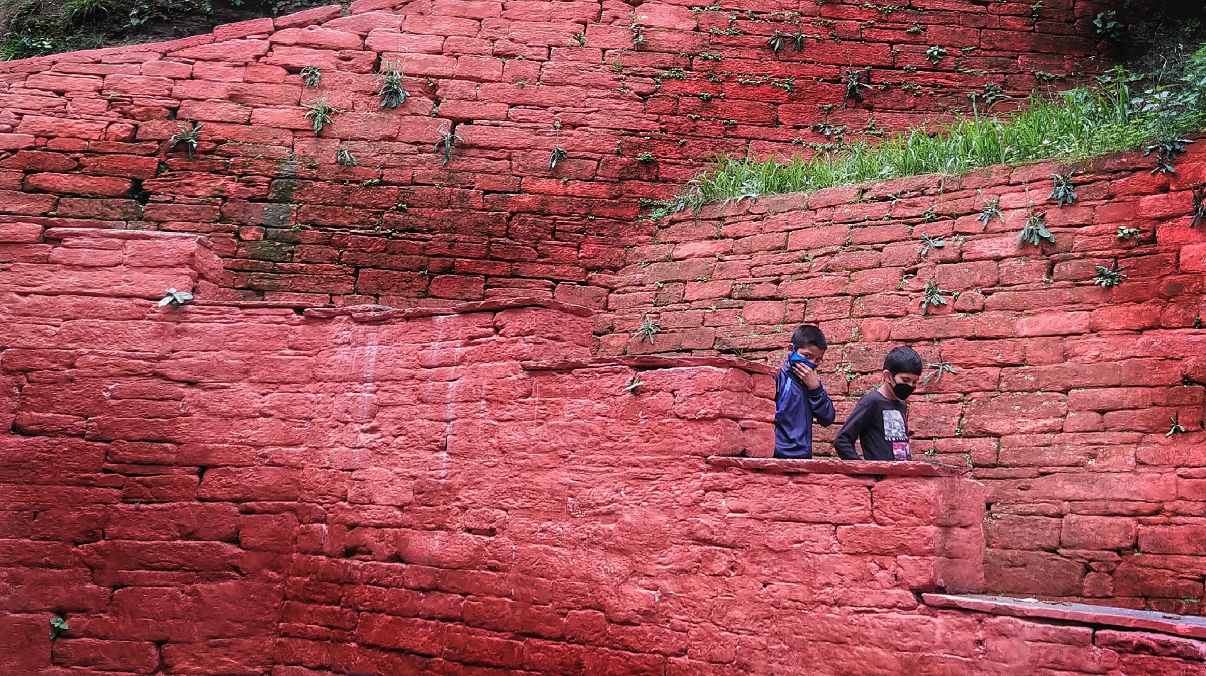 Hidden stairs behind the red wall