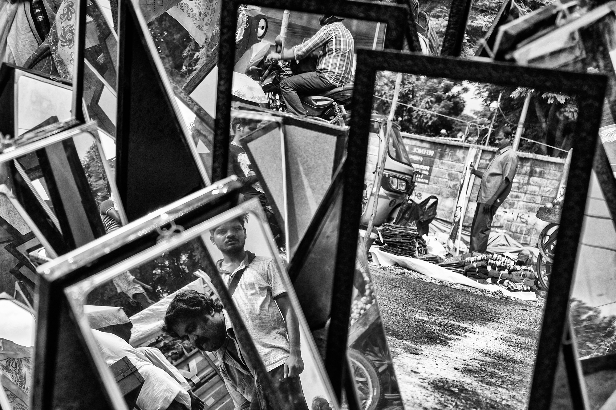 A roadside mirror shop where lots of mirrors were for display and it was looking very dramatic in the reflection of those mirrors. The toughest part was to hide my presence in the frames.