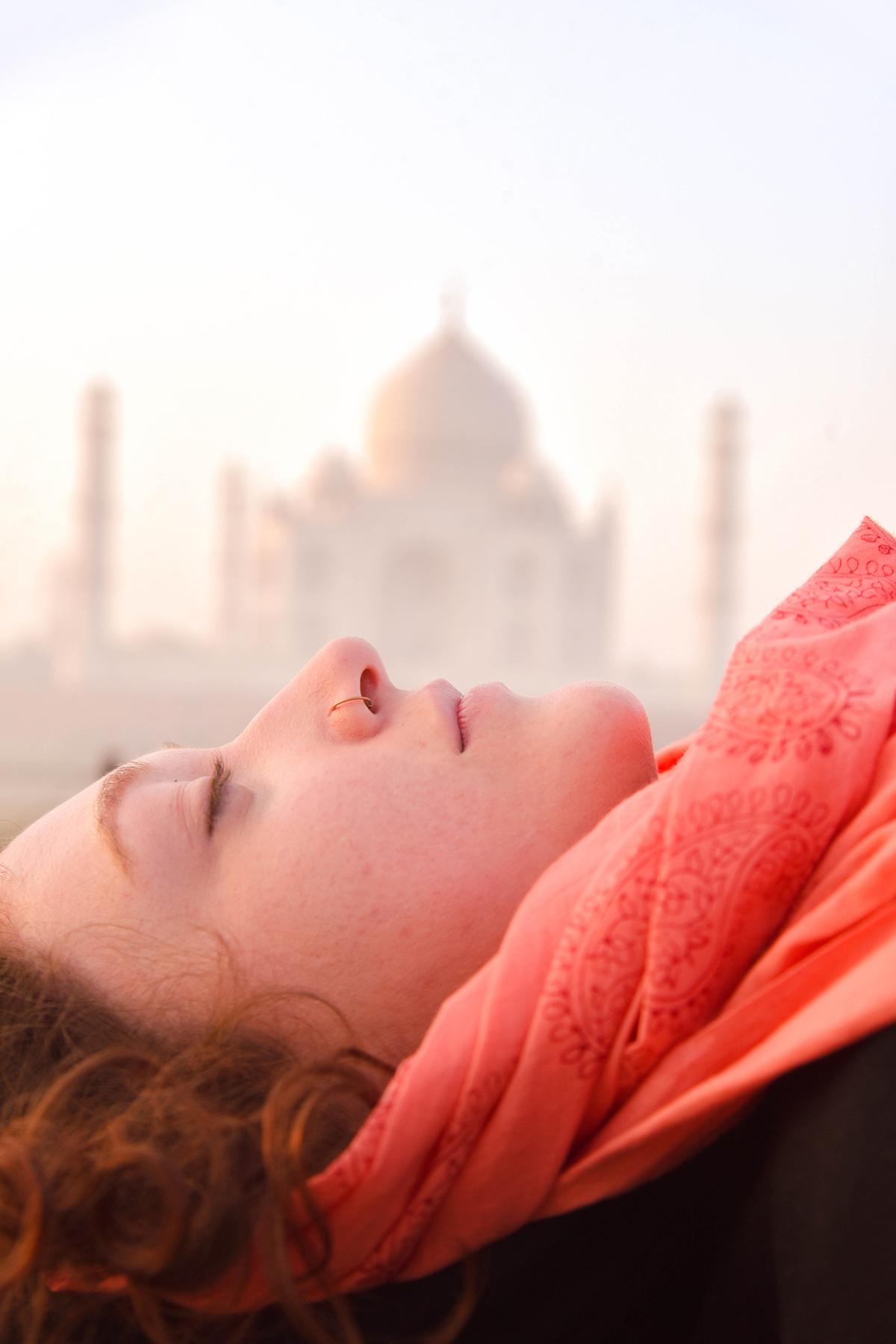 this photo taken from delhi (india) she seems like mumtaz (for her memmories emperor shajahan  built tajmahal )dreaming taj