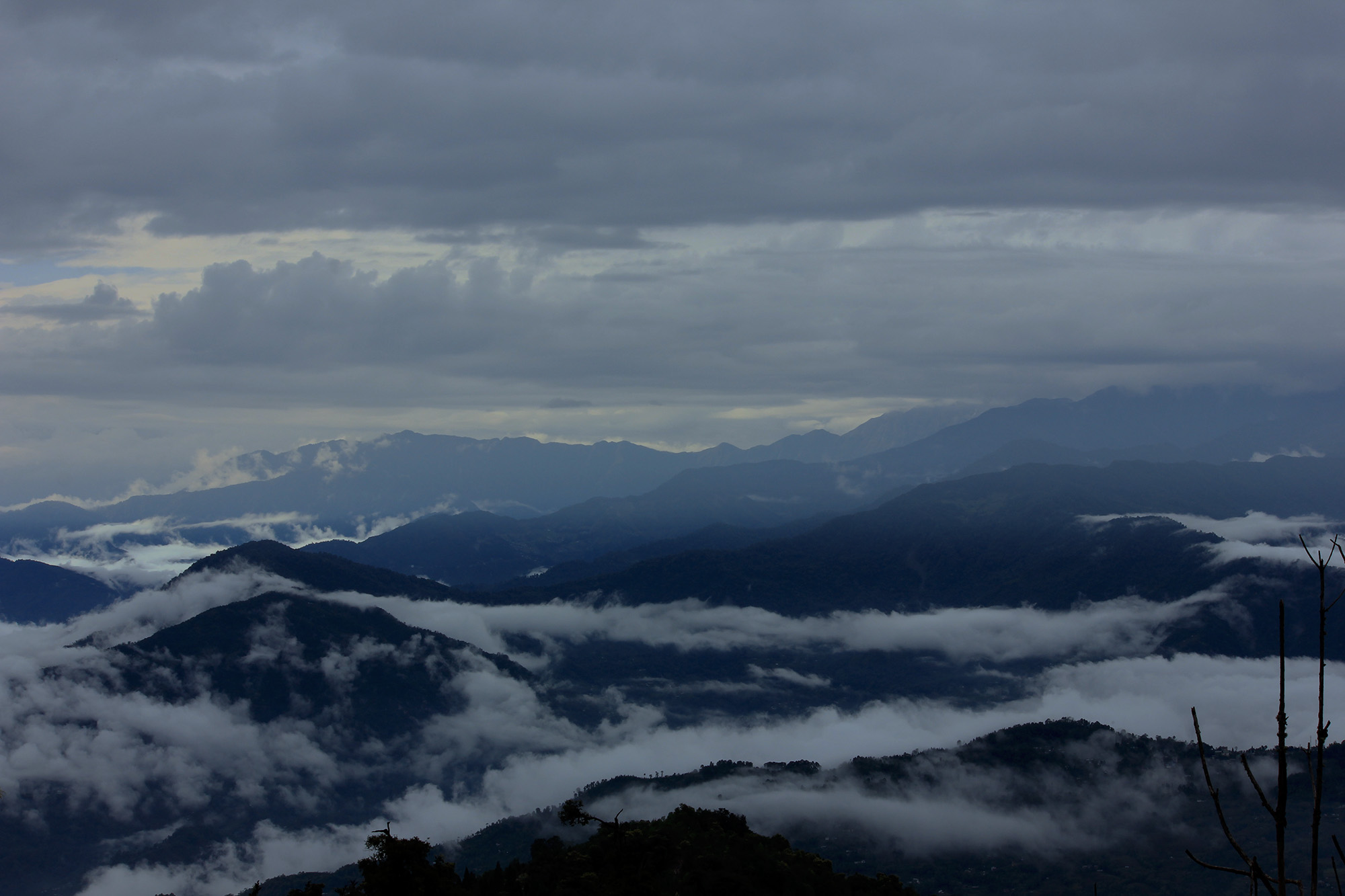 this photo taken at rishyap after the rain was stopped.clouds are playing with their friend hills.