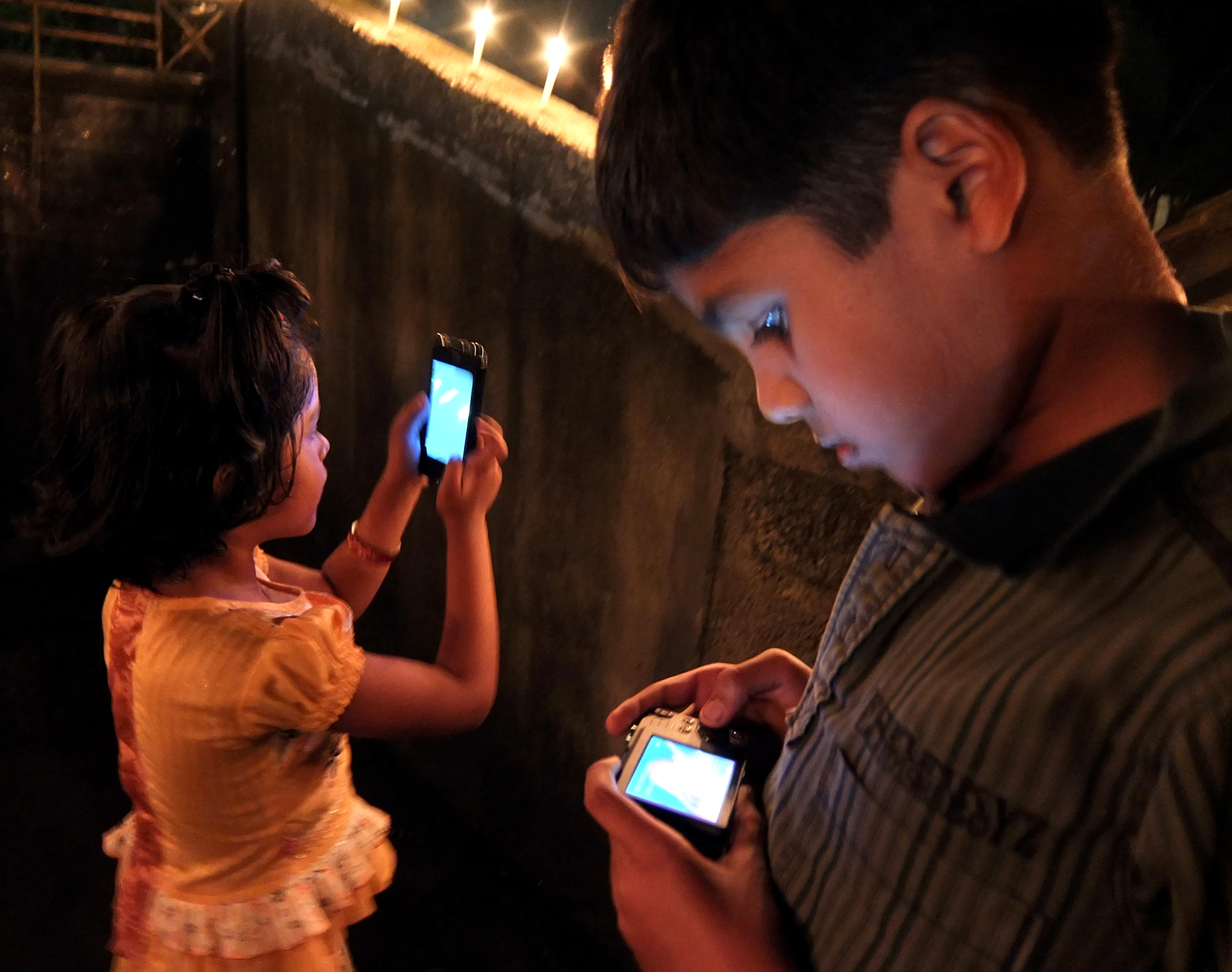 Uma,my daughter is busy capturing Karthika lights in our home while her brother Amal is reviewing the shot he just clicked.