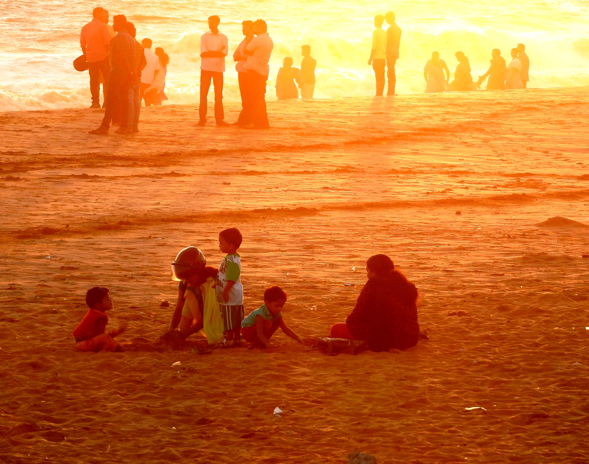I was always fascinated to have this  family pictures where sunset  light was in a golde yelow hue.I was astonished by the by the frame I got.This photo oppurtunity arrived when we had a visit to a beach during the sunset time.What I want to capture was that the beauty of  sunlights over the beach sand. Camera :  Nikon Coolpix P 610