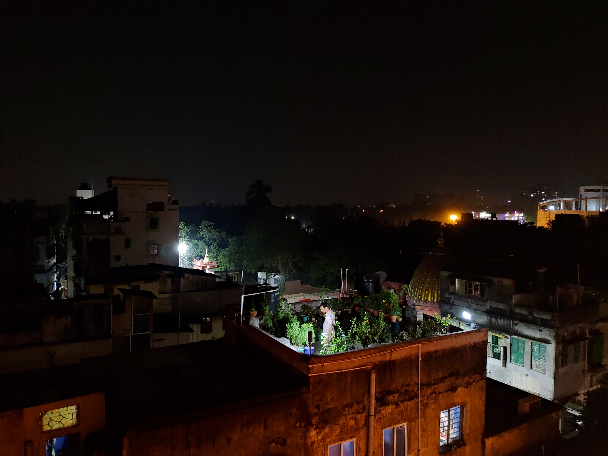 Saw this man watering his plants at night while I was covering a wedding assignment