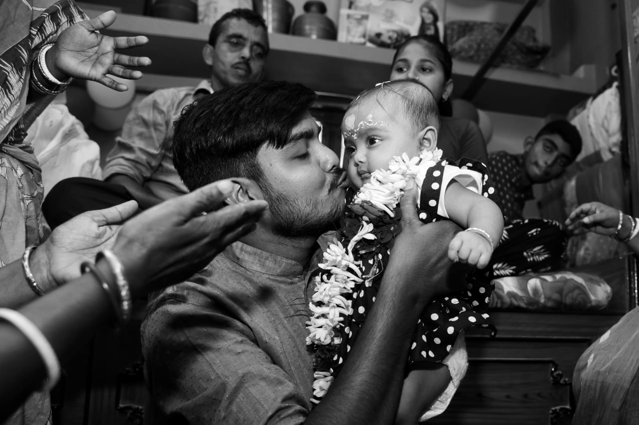 This picture was clicked during the rice ceremony of Rahi. While clicking this picture what attracted me the most was the innocence in her eyes and the love and affection on her uncle's face.