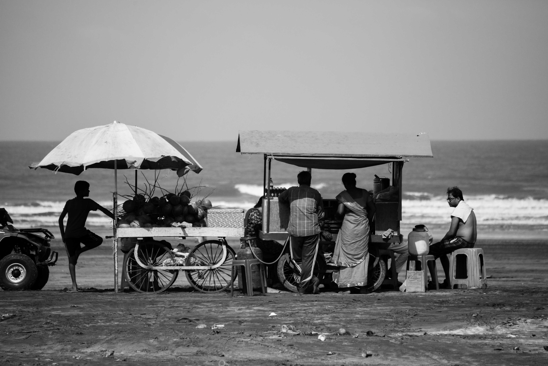 The couple serving snacks and tea at the beach o a very long time and earning their live hood.