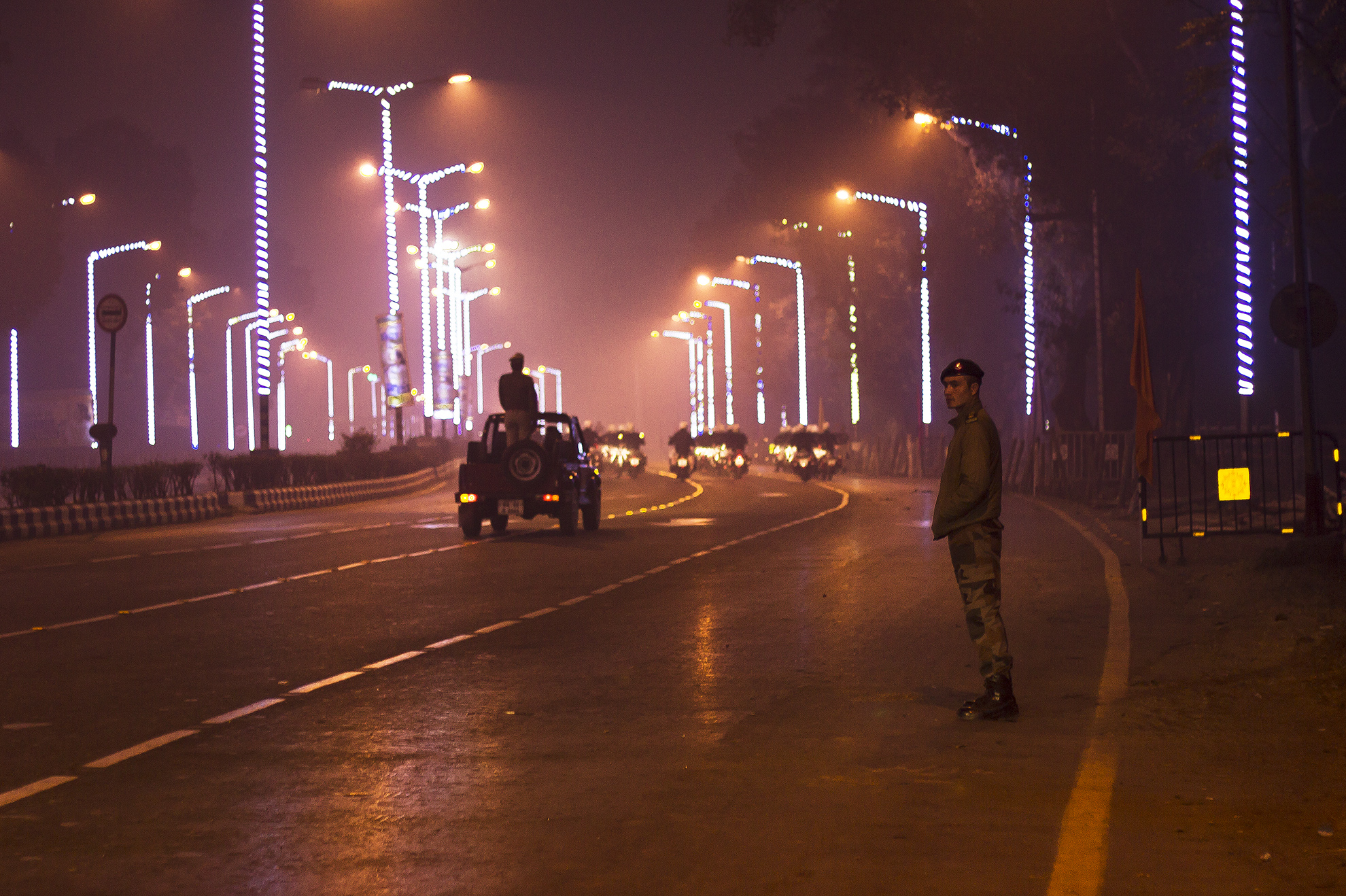 a military man standing beside the road and assure safety during the practice of republic day parade practice