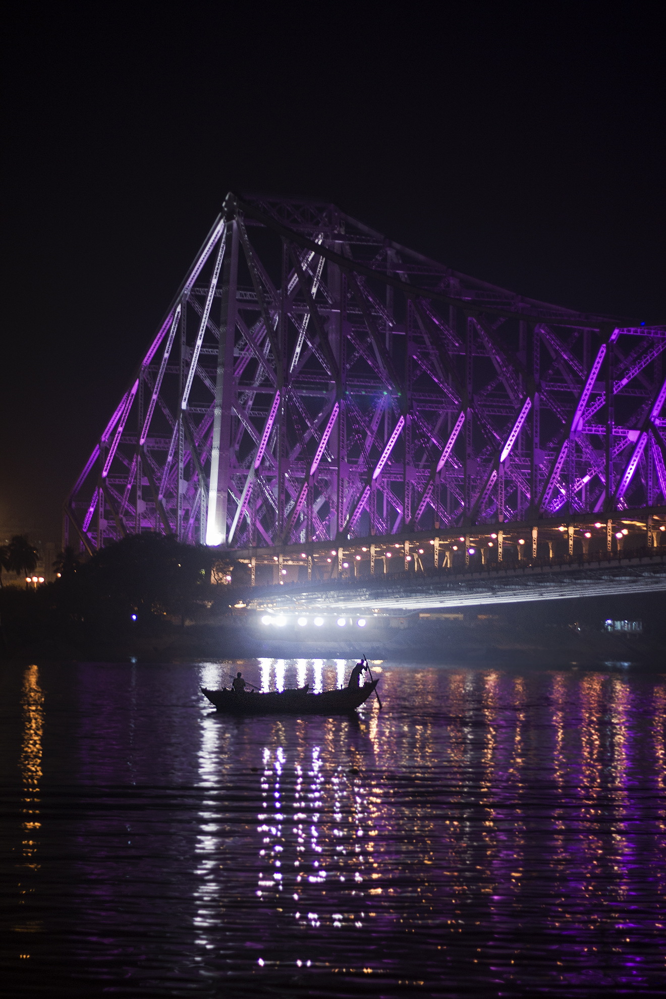 the iconic bridge at the time of dark , when it is decorated with lights
