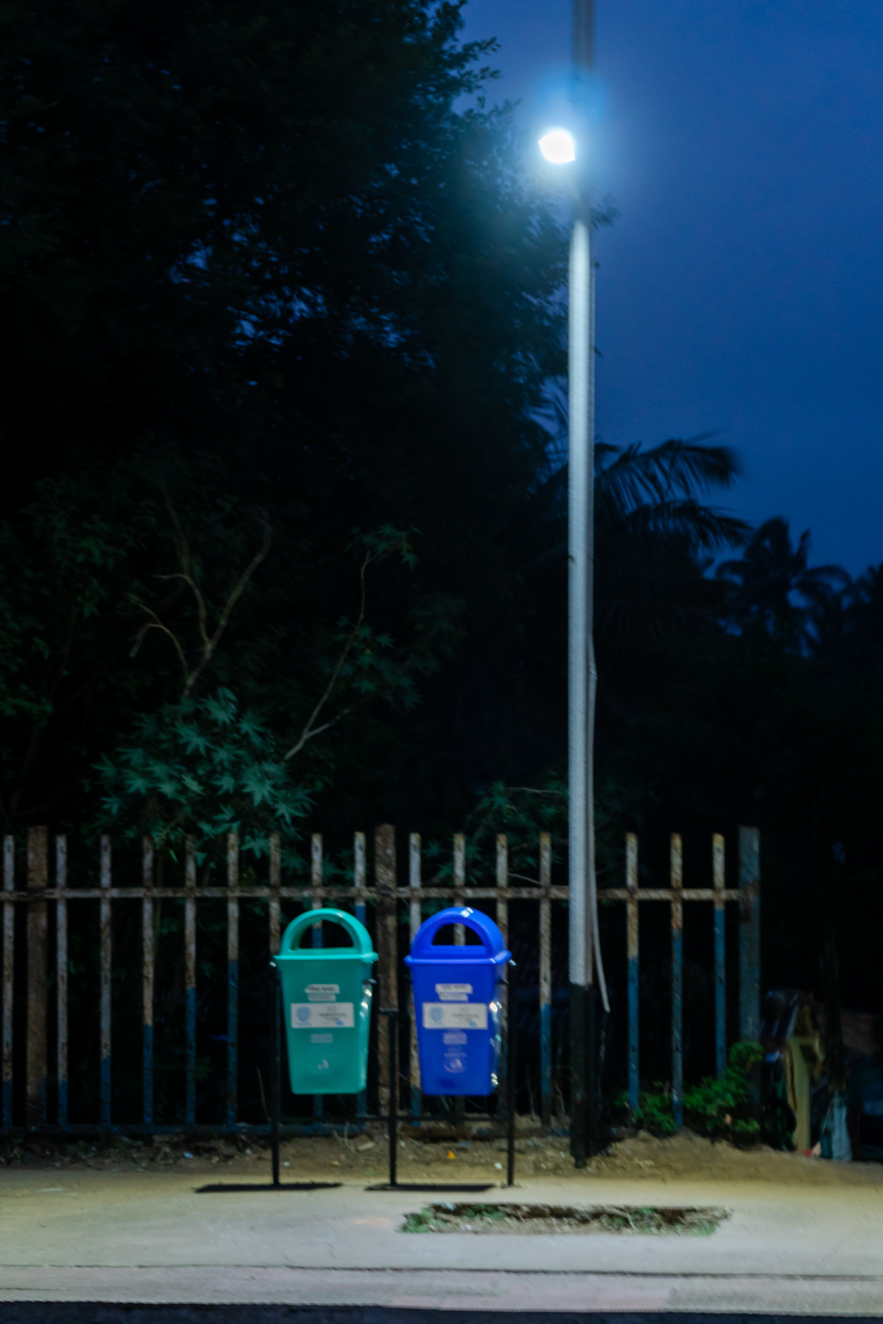 On way back to home, I noticed the spot light on the two garbage bins.  I wanted to show the geometry, shapes in the image.  For me the garbage bins seemed like a couple, having a relation with the lamp besides them.