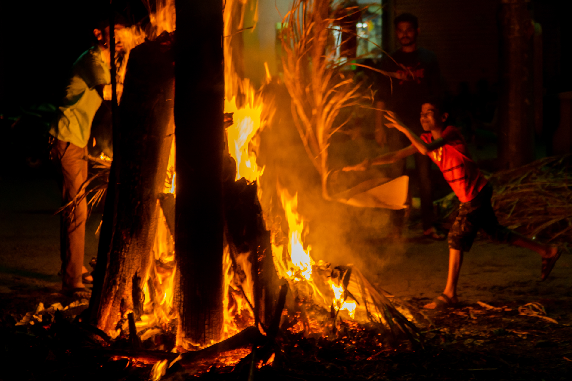 The holi festival in konkan is on of the biggest festivals celebrated there, in which all age group people participate.  Here the kid was doing his part of job, and contributing in the holi, not bothering of the size of the fire.