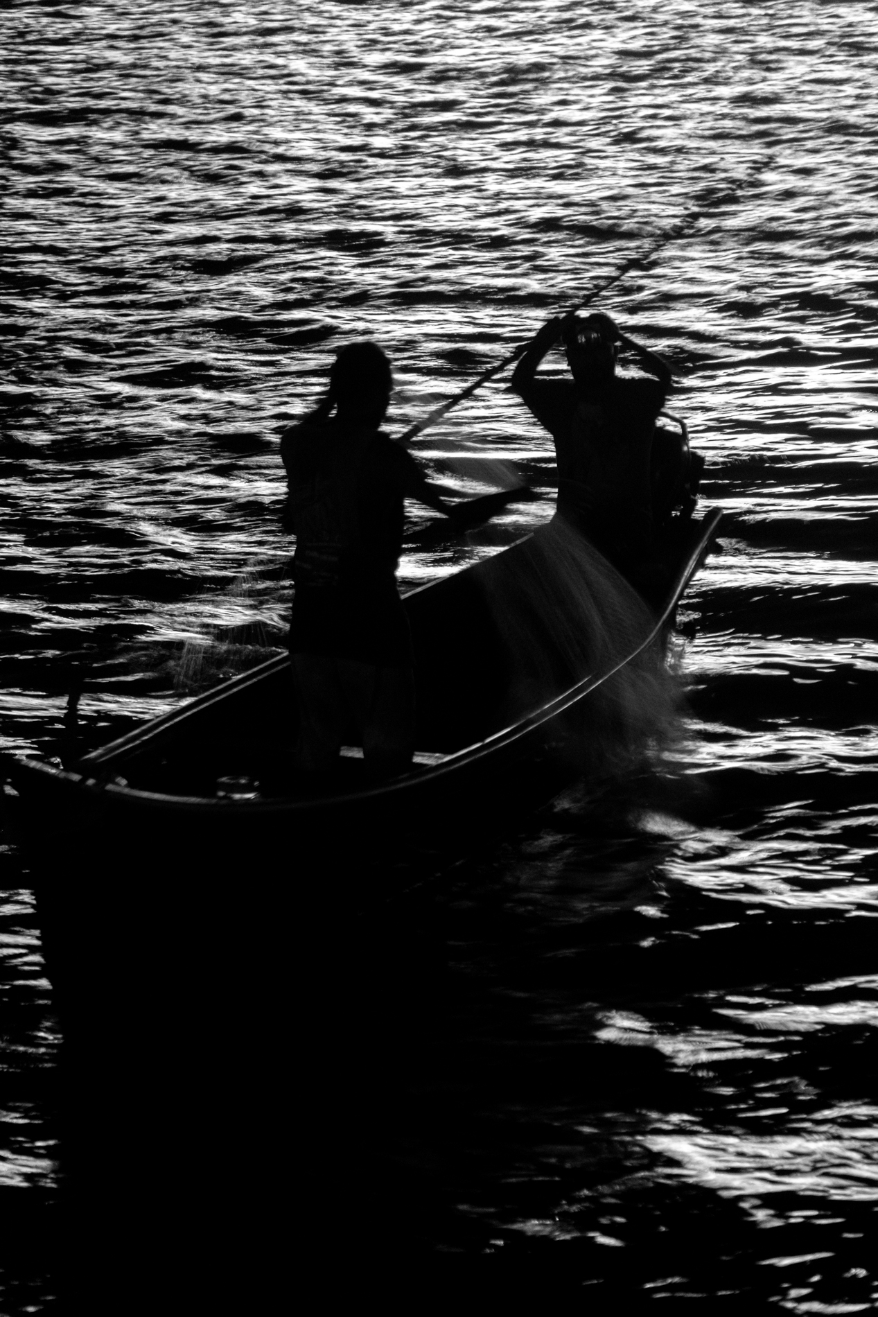 Risking their lifes, by doing such a tough job of fishing in night.