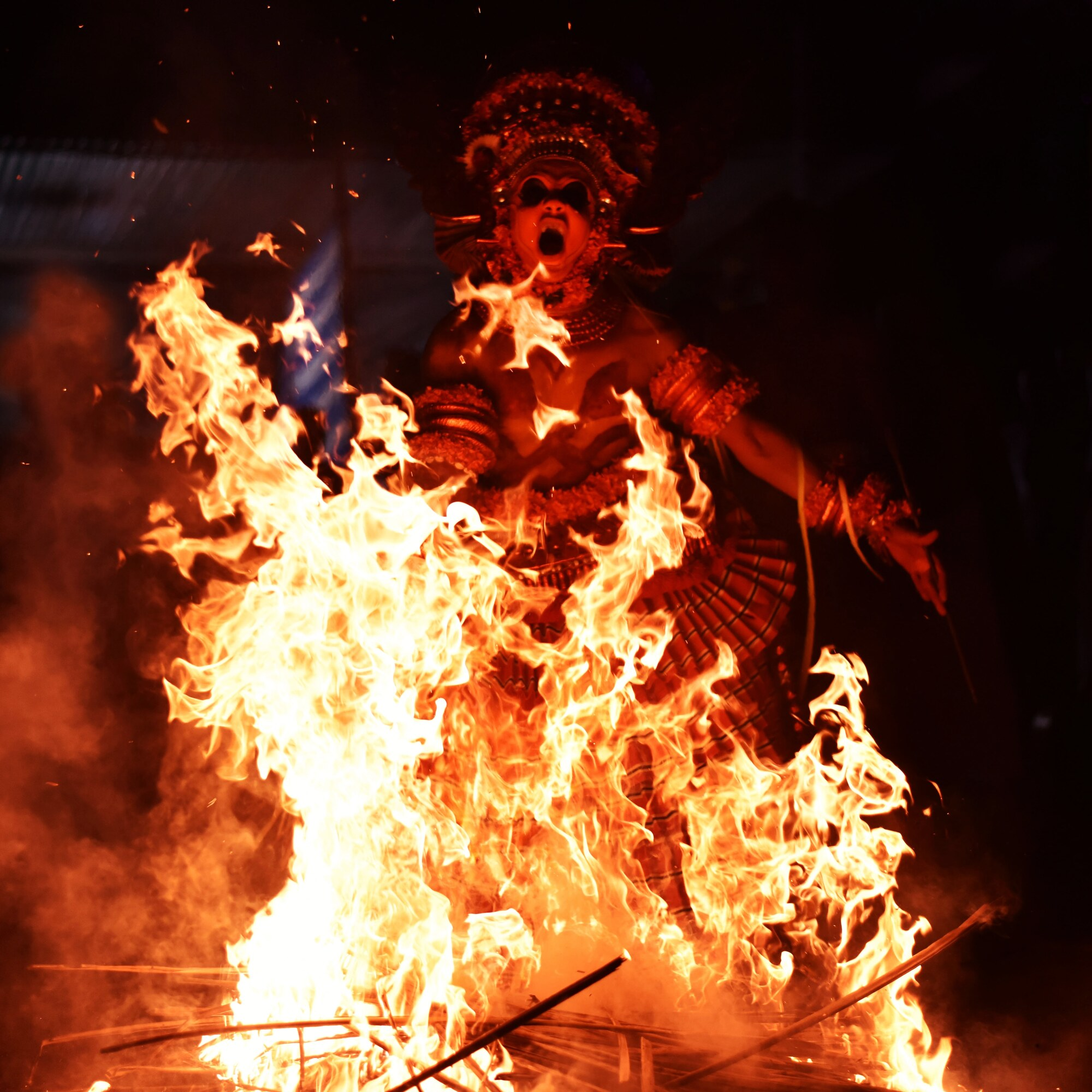 It was from a traditional theyyam event in Kerala so that red ambience from fire , made me feel strong on human cultures and practices