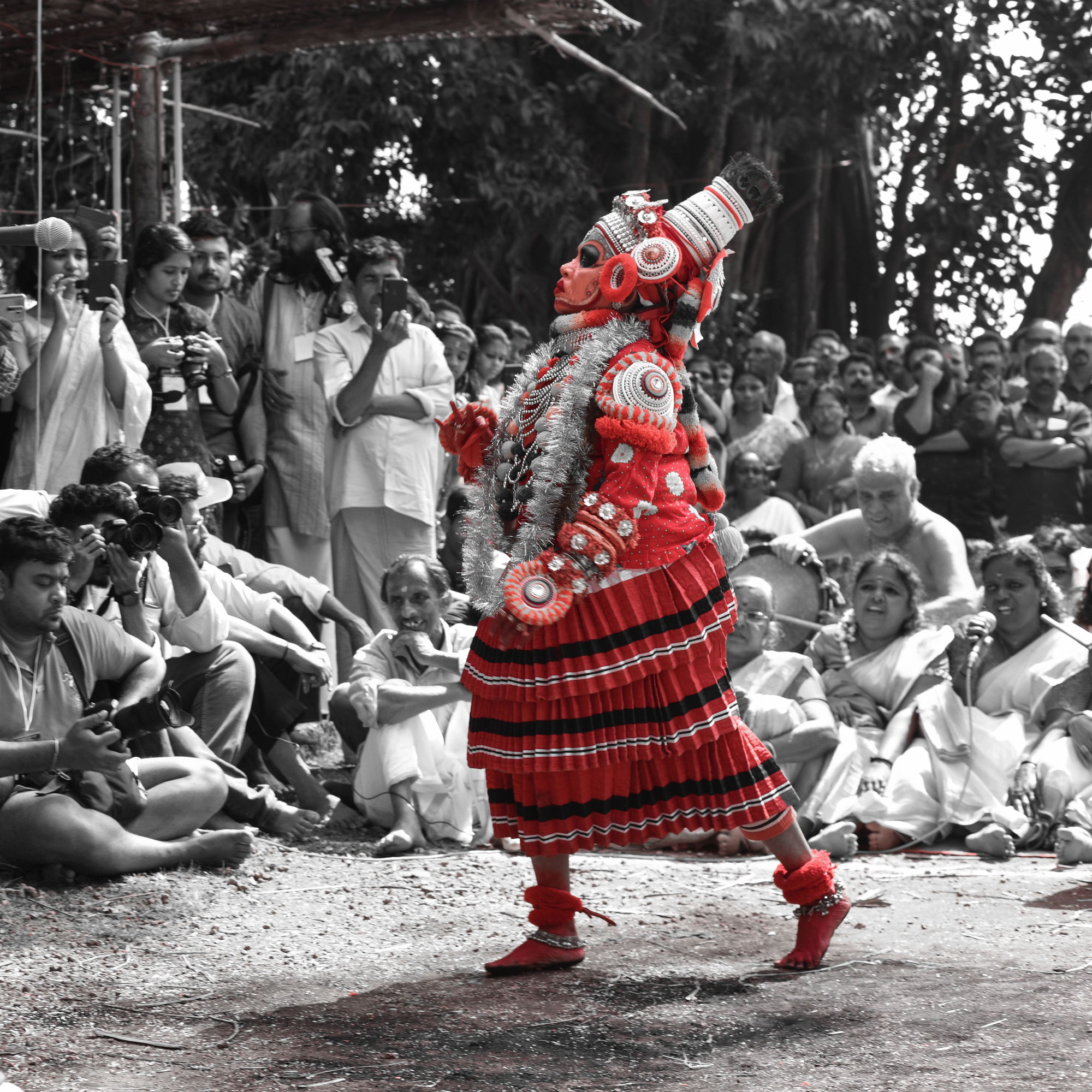 It was a dance show in a traditional theyyam event in Kerala so that red costume stood out in the crowd , which showed how strong they are in culture and practices and how strong are womens