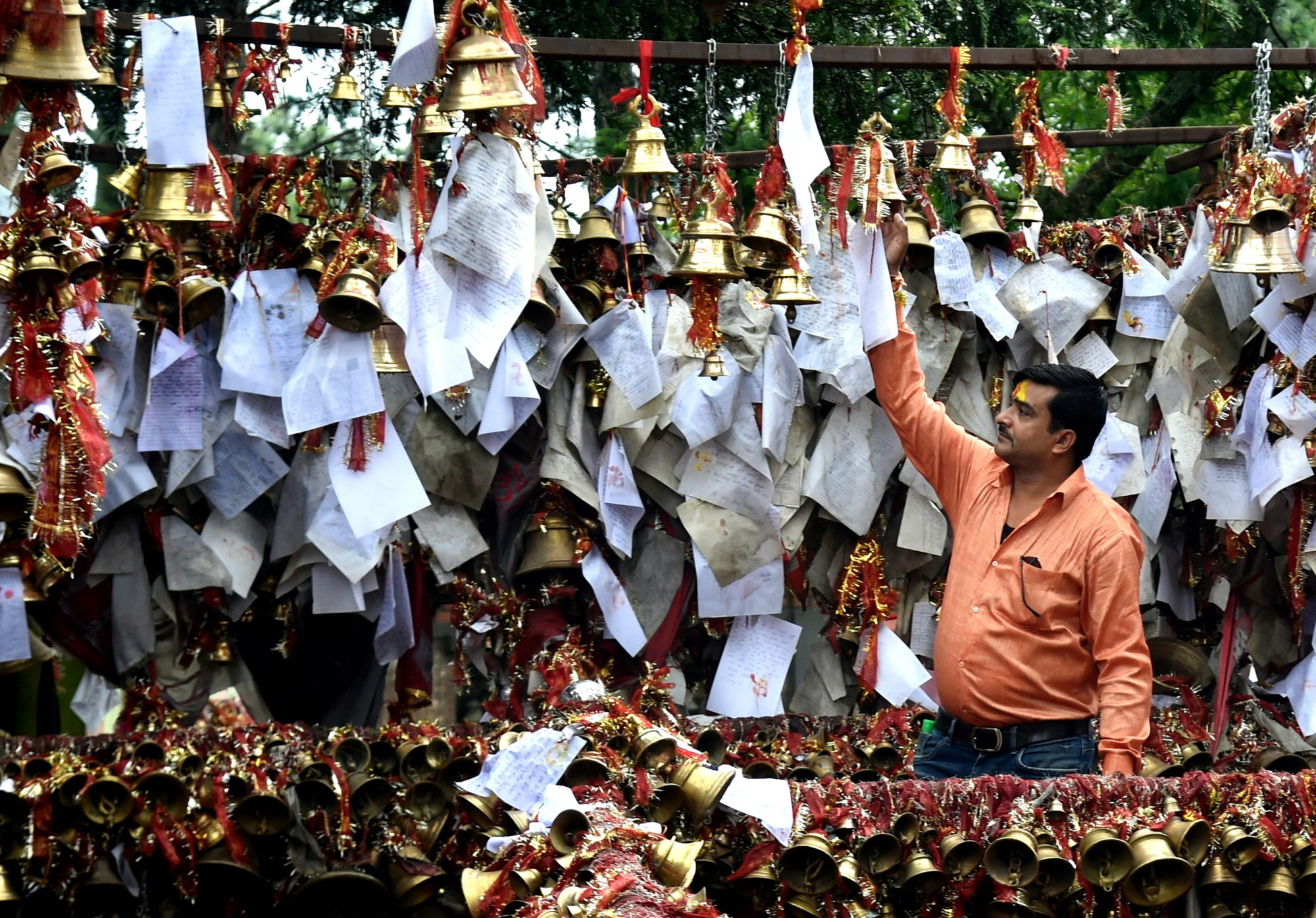 Chitai Golu Devta Temple in Almora. People write their wish on paper and some even on a government registered note and tie somewhere in the temple, The Lord listens and grants your wish. As a token of thanks, you return and tie a brass bell at the temple.