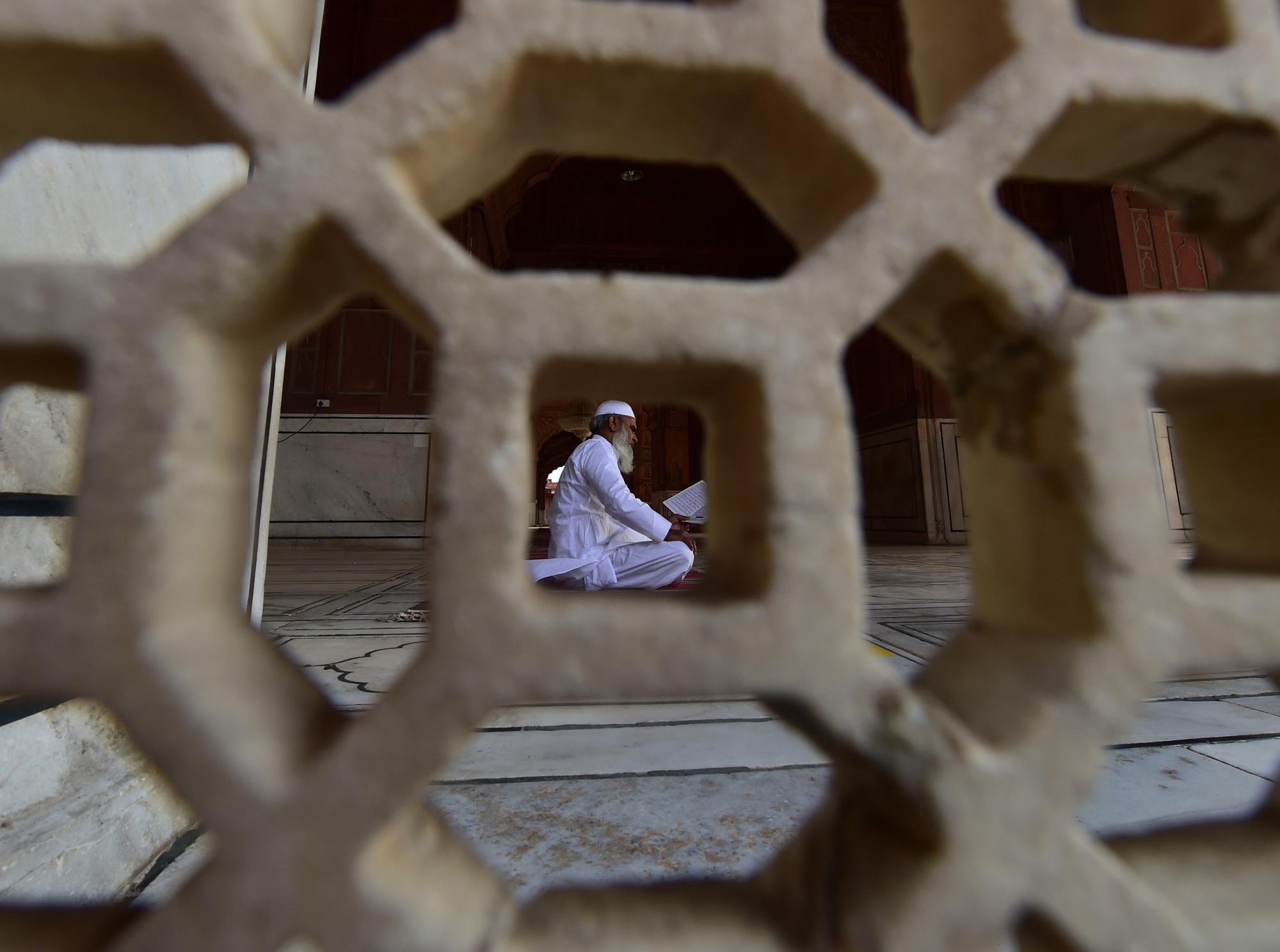A Muslim read holy book  at Jama Masjid