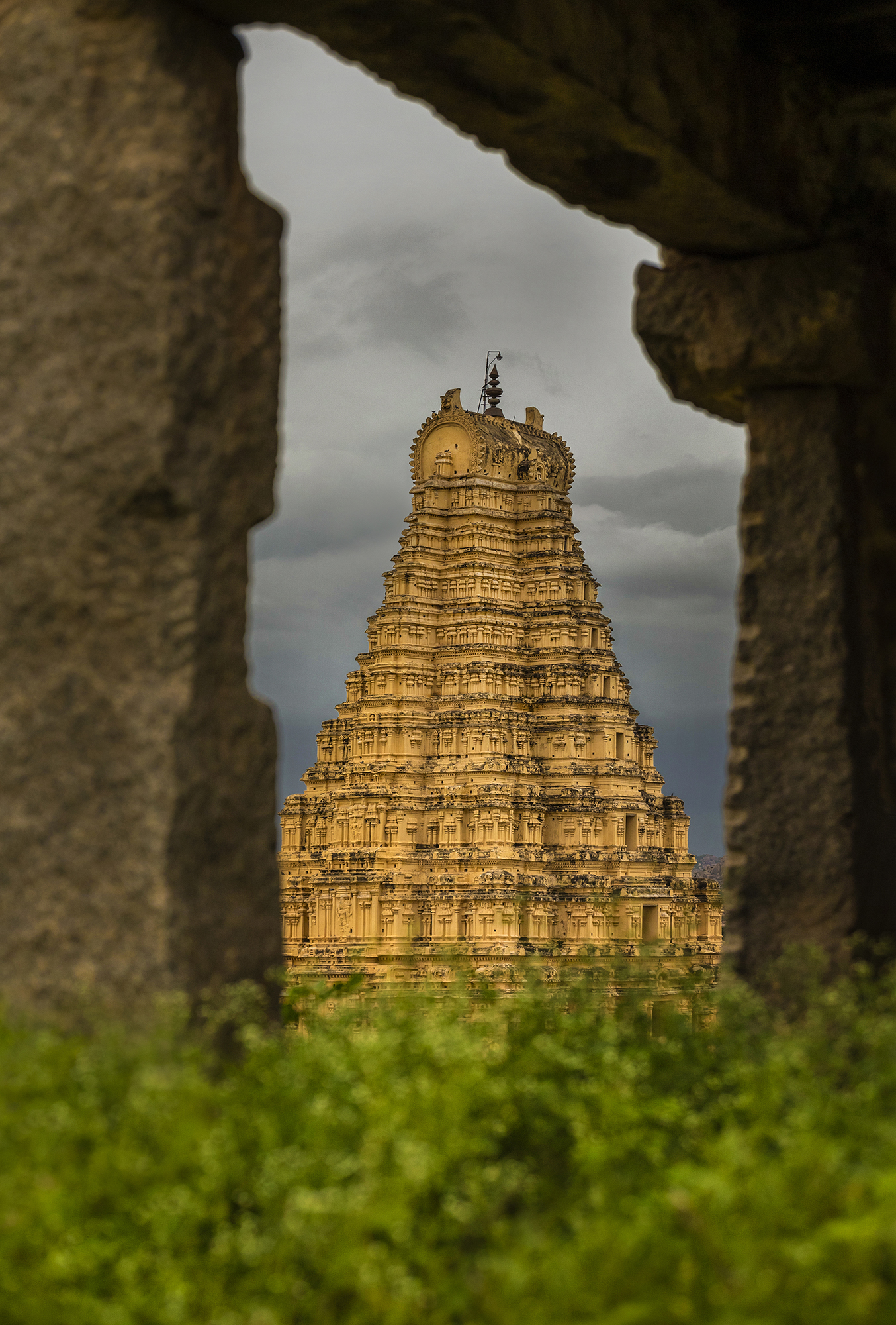 Taking unique perspective is always my favorite. A frame with in frame of Virupaksha Temple from Land of Ruins, Hampi